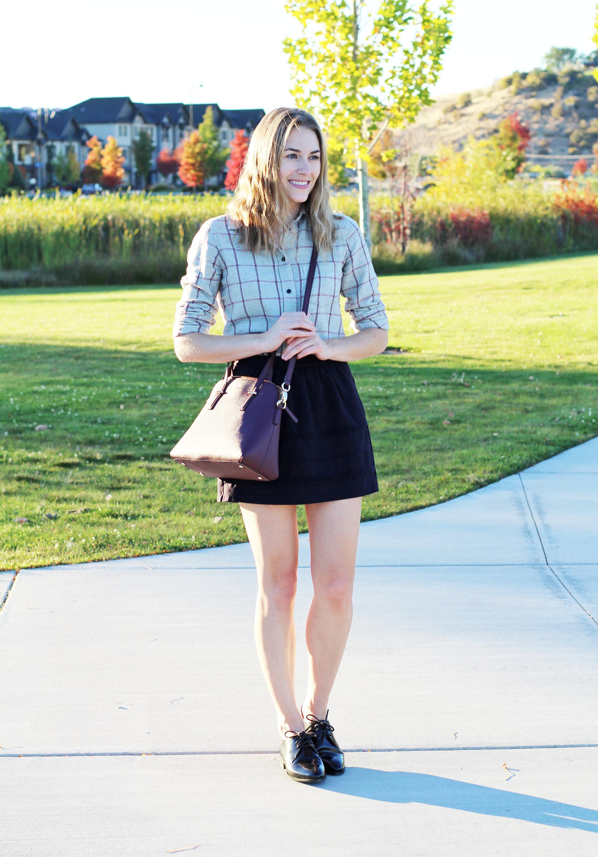 Kate Spade 'Cedar Street Maise' bag with grey windowpane flannel shirt, black mini skirt, shiny black oxfords — Cotton Cashmere Cat Hair