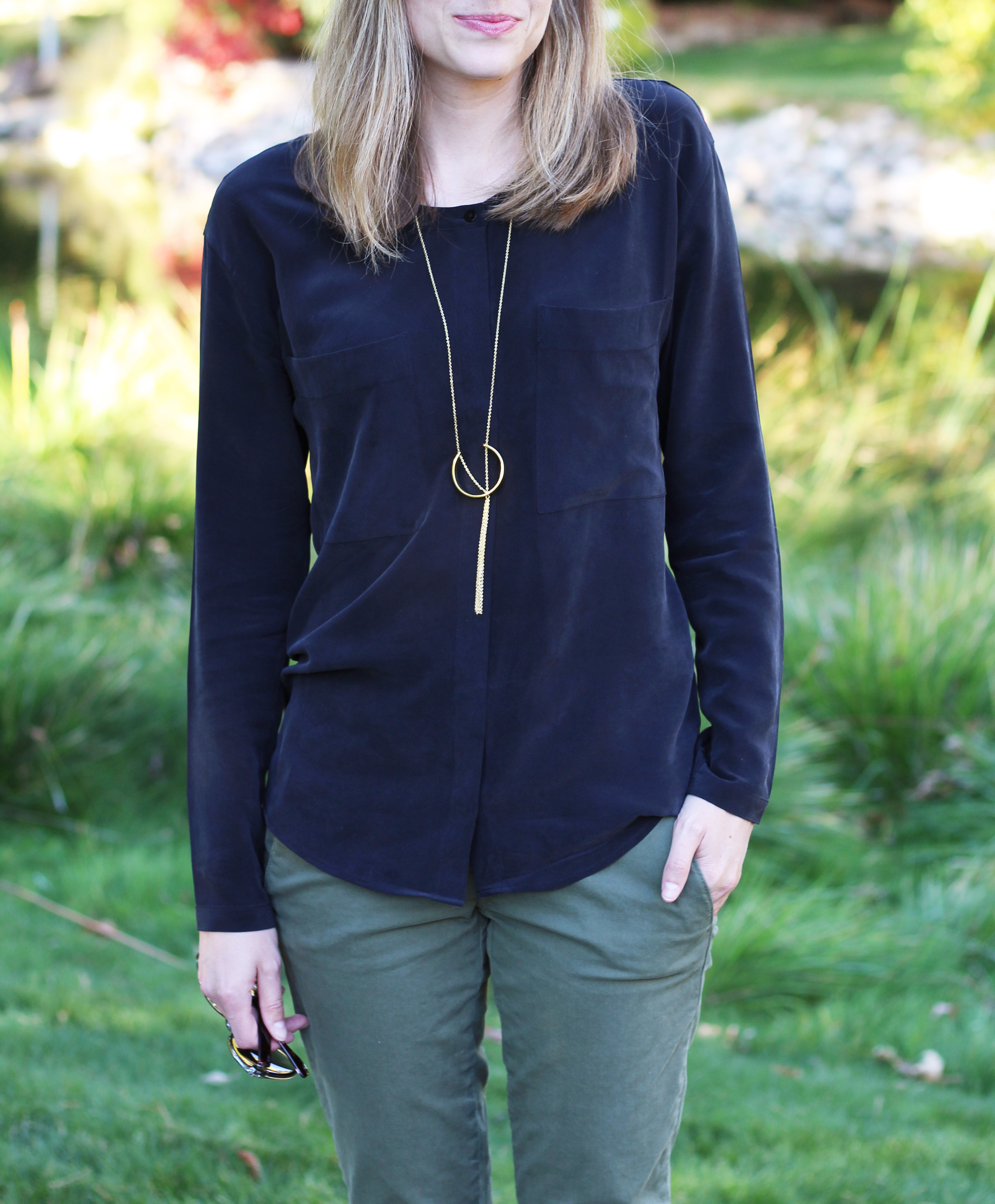 Black silk shirt outfit with pendant necklace and green pants — Cotton Cashmere Cat Hair
