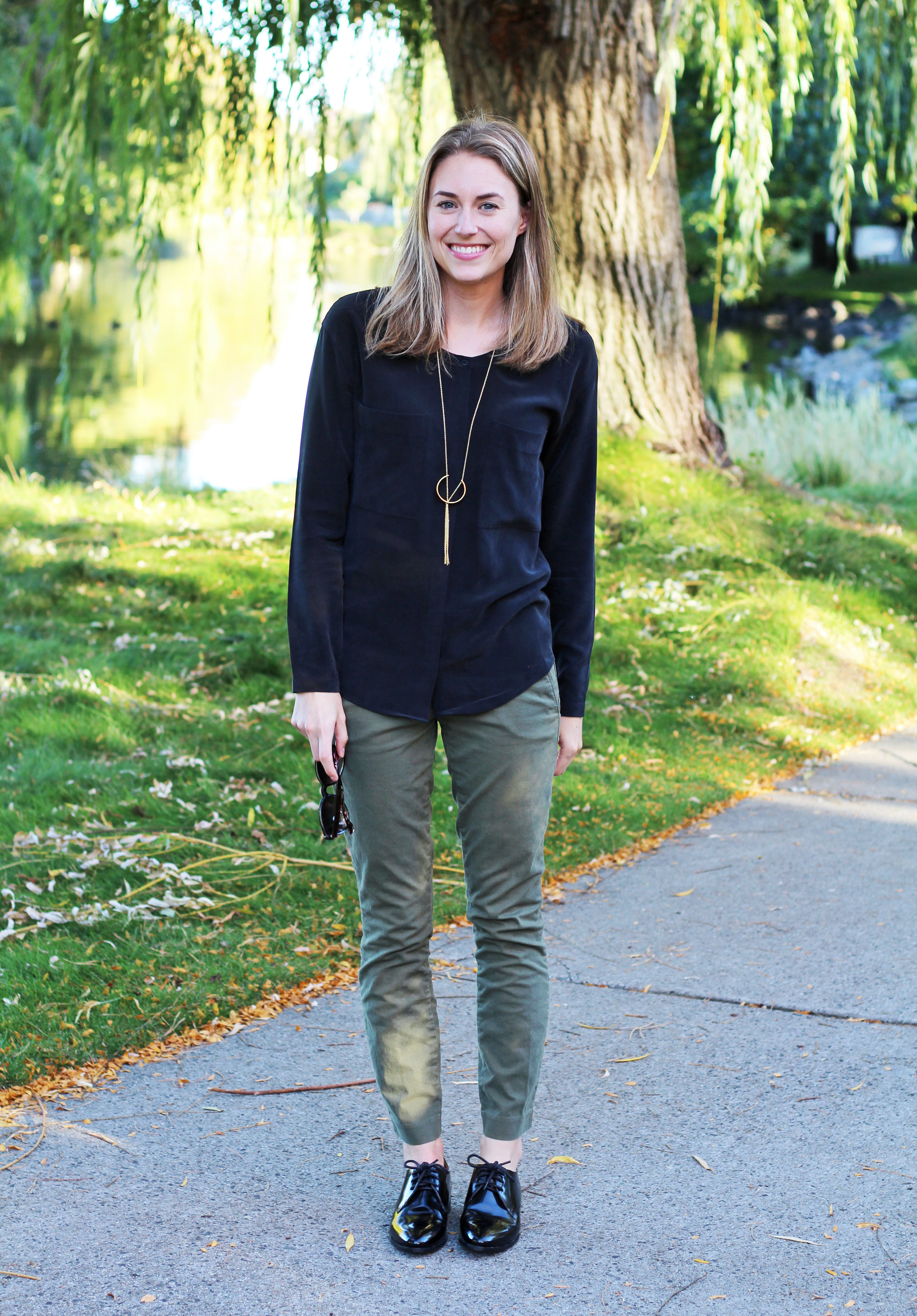 Fall outfit: Black silk shirt with green chino pants, black oxfords, and pendant necklace — Cotton Cashmere Cat Hair