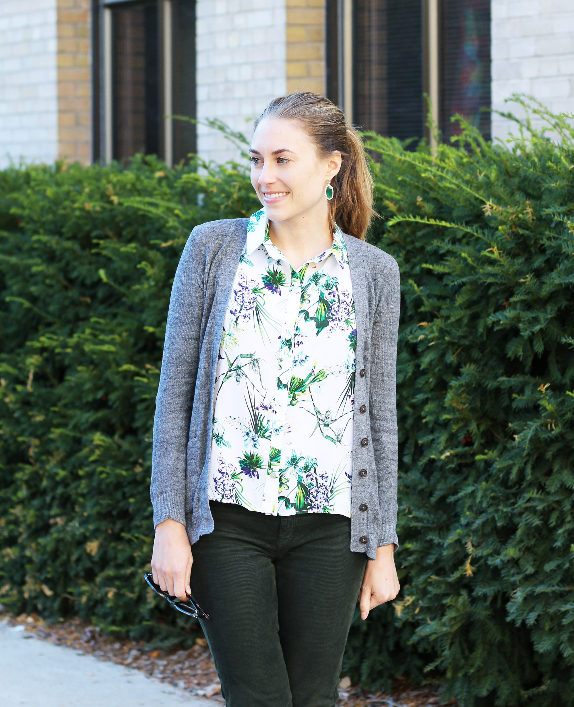 Amour Vert 'Riley' silk shirt in tropical with grey cardigan, green corduroy pants, Kendra Scott earrings — Cotton Cashmere Cat Hair