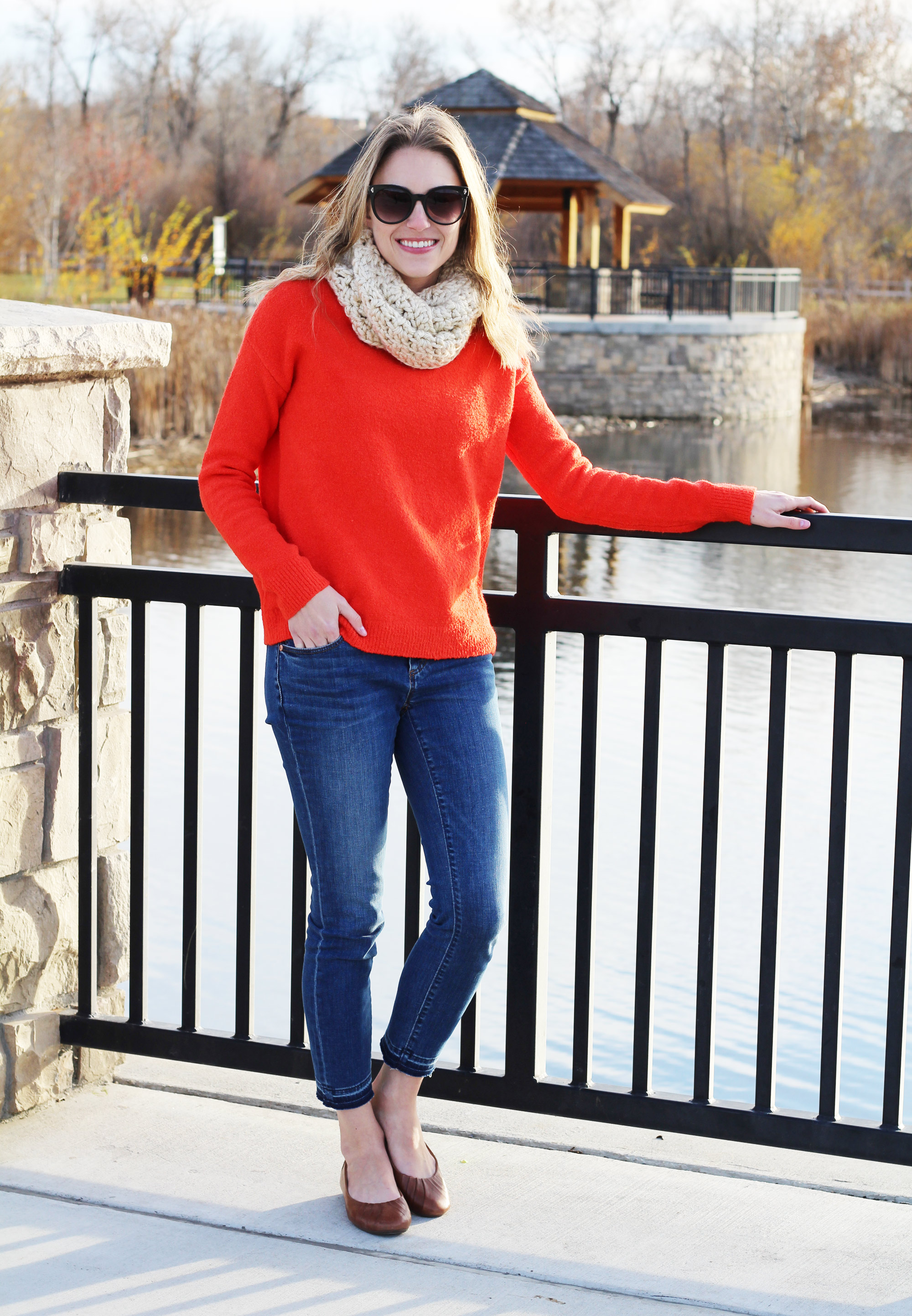 Red sweater outfit with skinny jeans, brown flats, cream scarf — Cotton Cashmere Cat Hair
