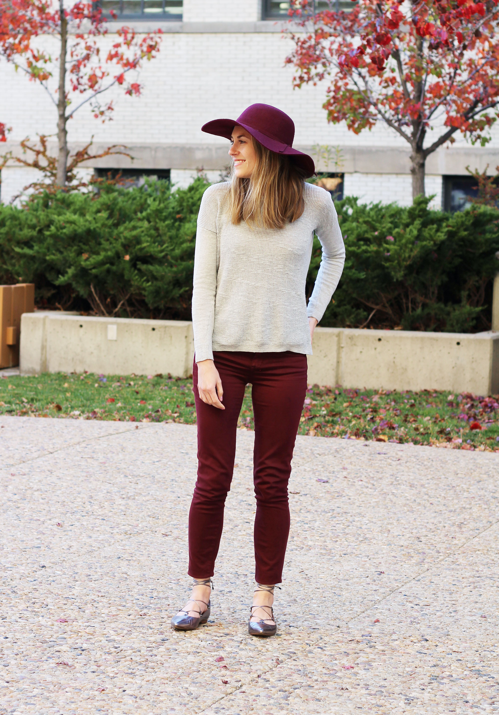 Burgundy wool hat outfit with grey sweater, burgundy pants, lace-up flats — Cotton Cashmere Cat Hair