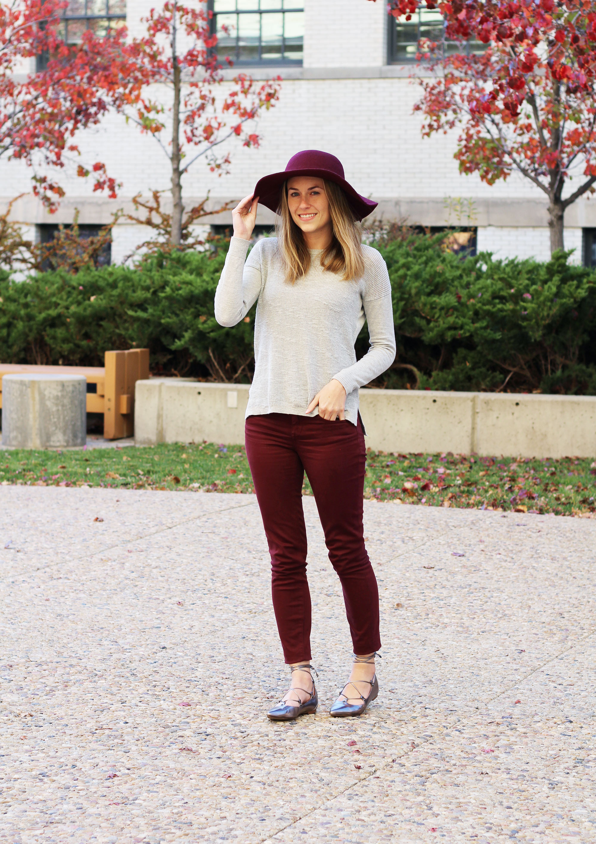Burgundy pants outfit with burgundy hat, grey sweater, lace-up flats — Cotton Cashmere Cat Hair