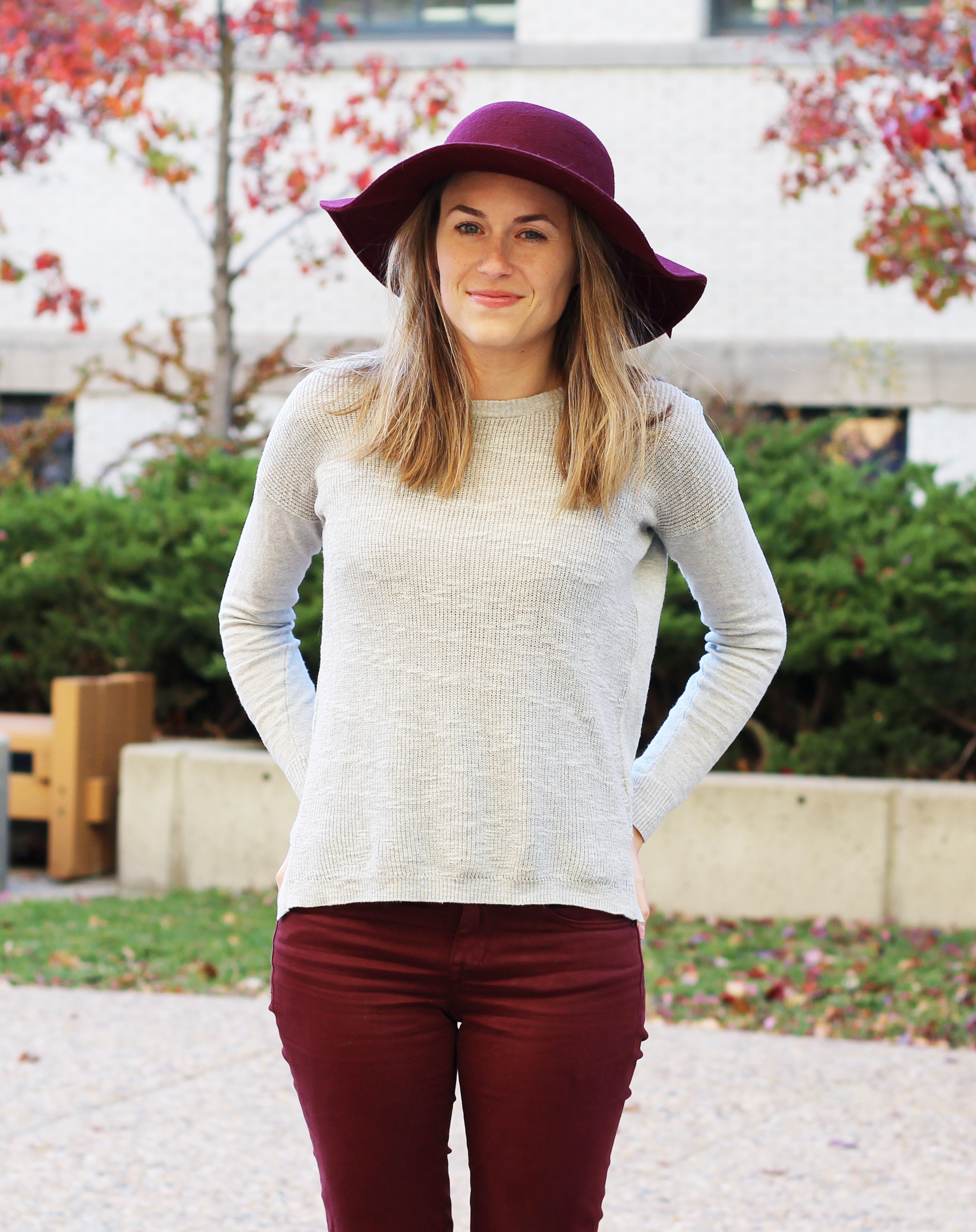 Burgundy floppy hat, grey sweater, burgundy pants — Cotton Cashmere Cat Hair