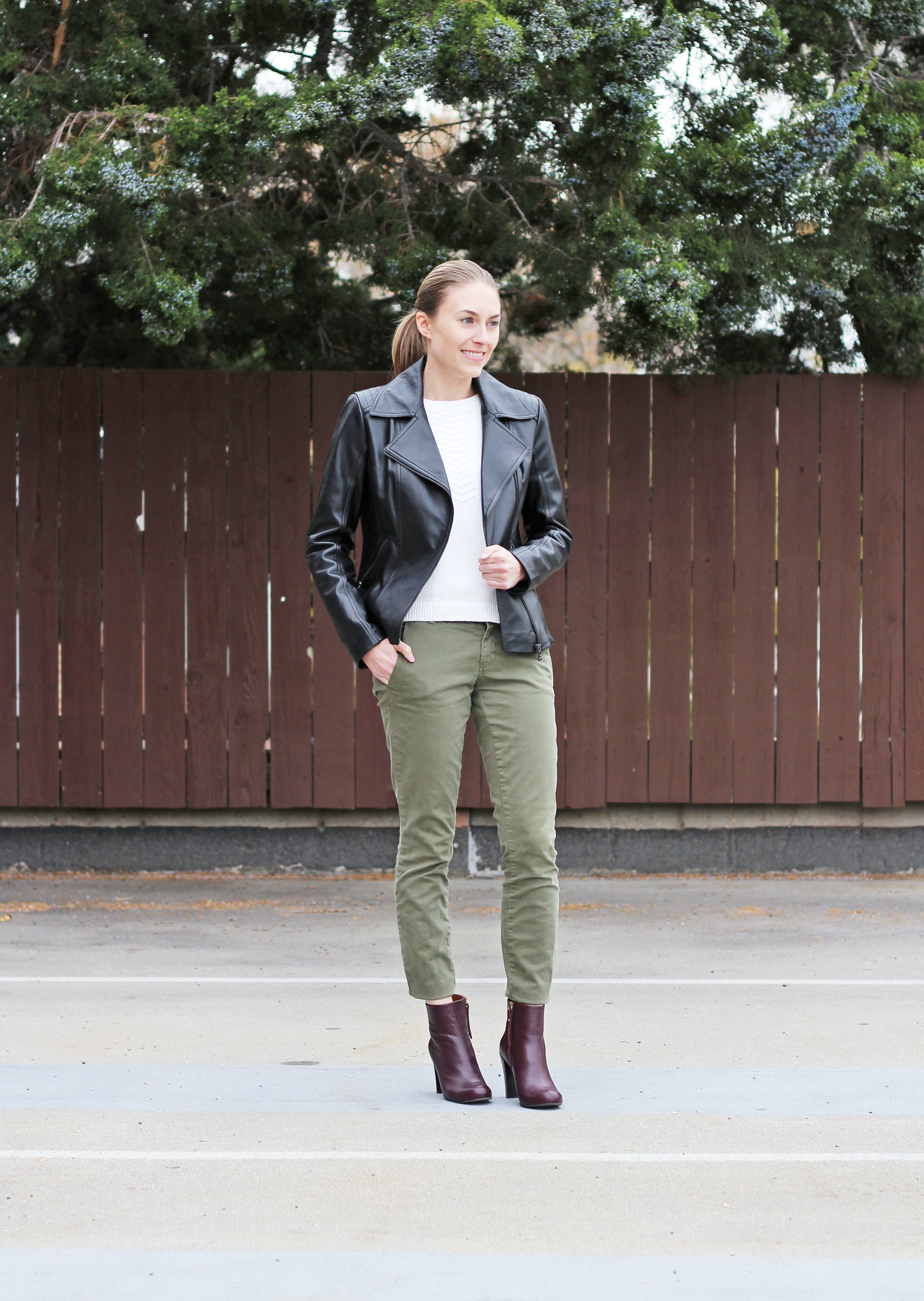 Fall outfit with leather jacket, ivory sweater, green pants, burgundy ankle boots — Cotton Cashmere Cat Hair