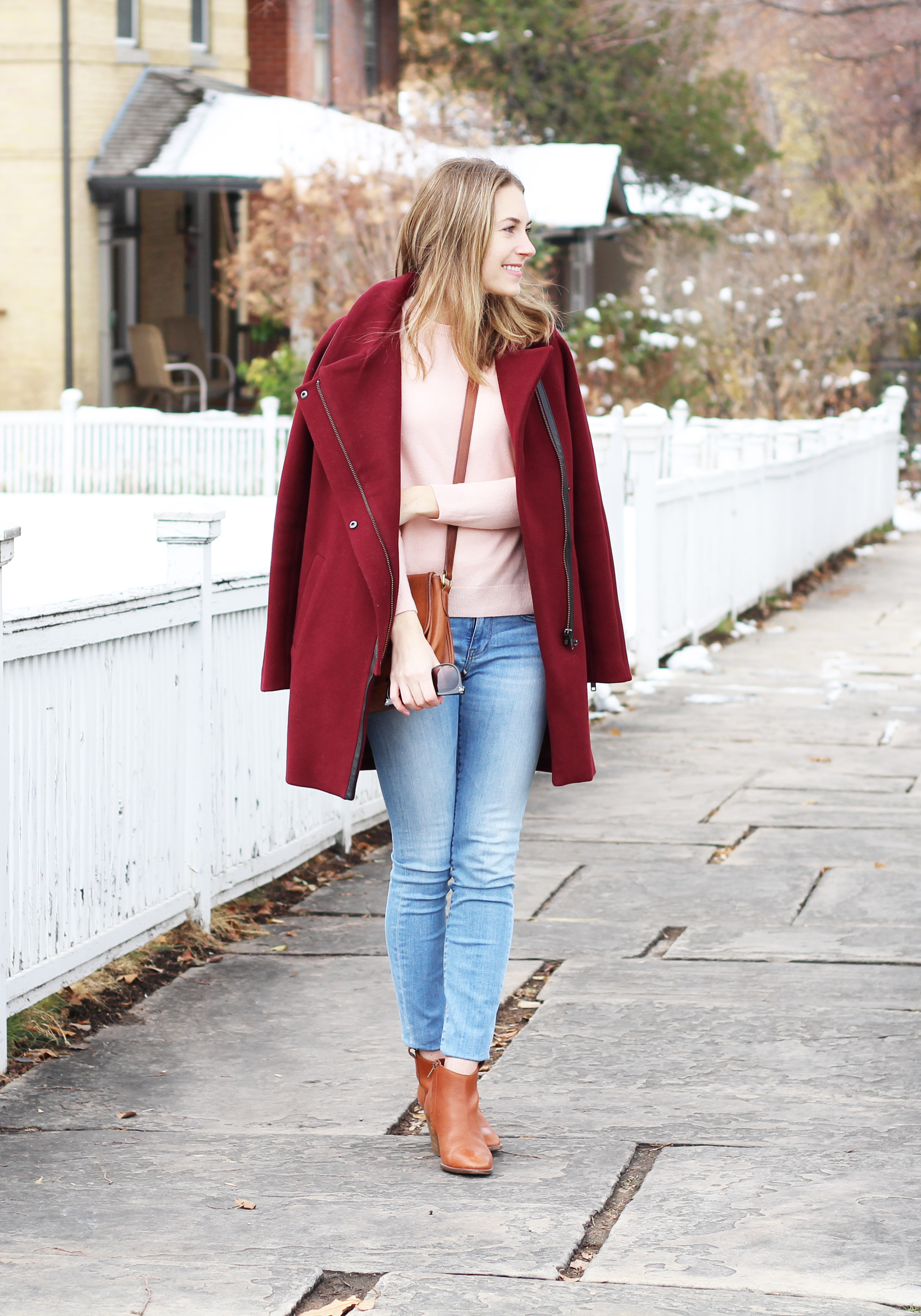 Burgundy coat, blush pink sweater, light wash denim, cognac ankle boots — Cotton Cashmere Cat Hair