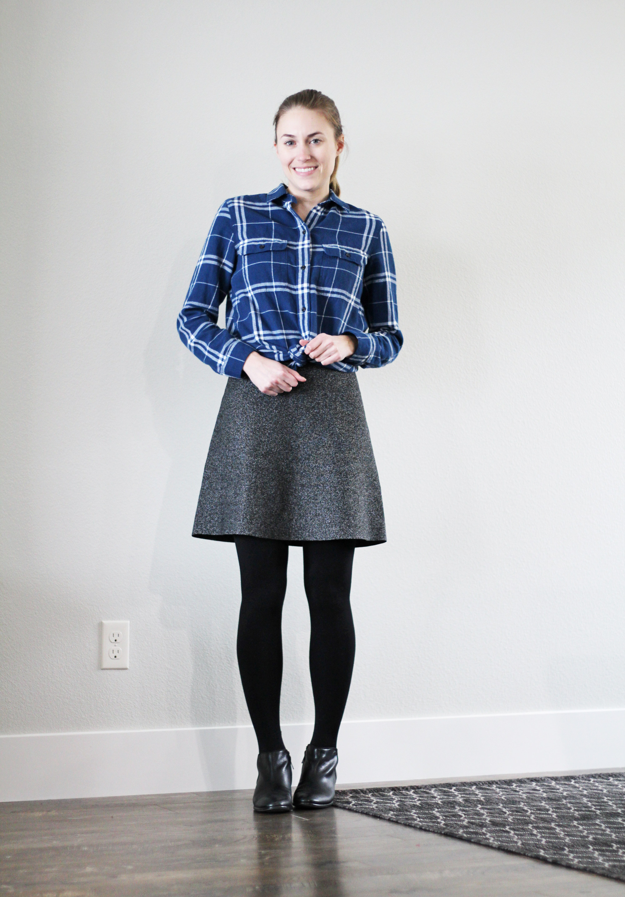 Blue plaid flannel shirt tied over speckled skirt — Cotton Cashmere Cat Hair