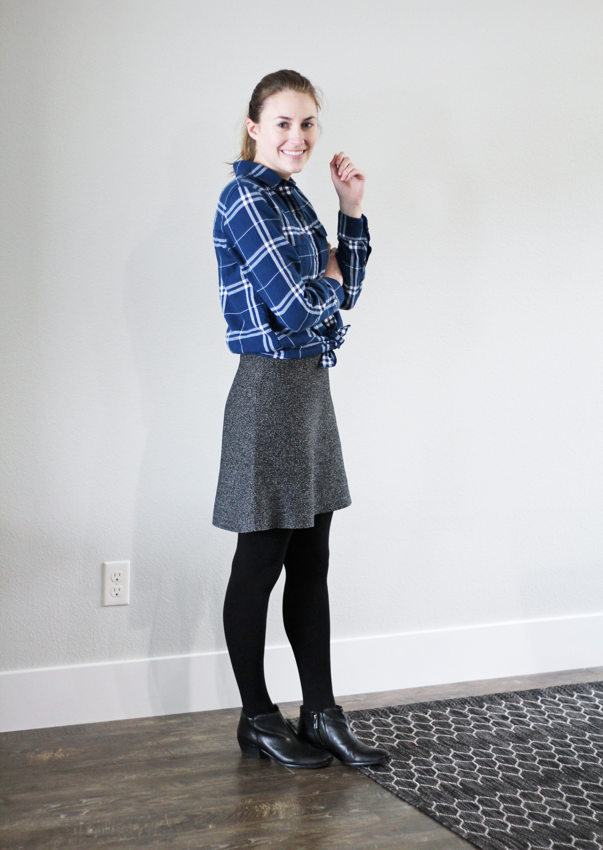 Blue plaid flannel shirt outfit with speckled skirt and black ankle boots — Cotton Cashmere Cat Hair