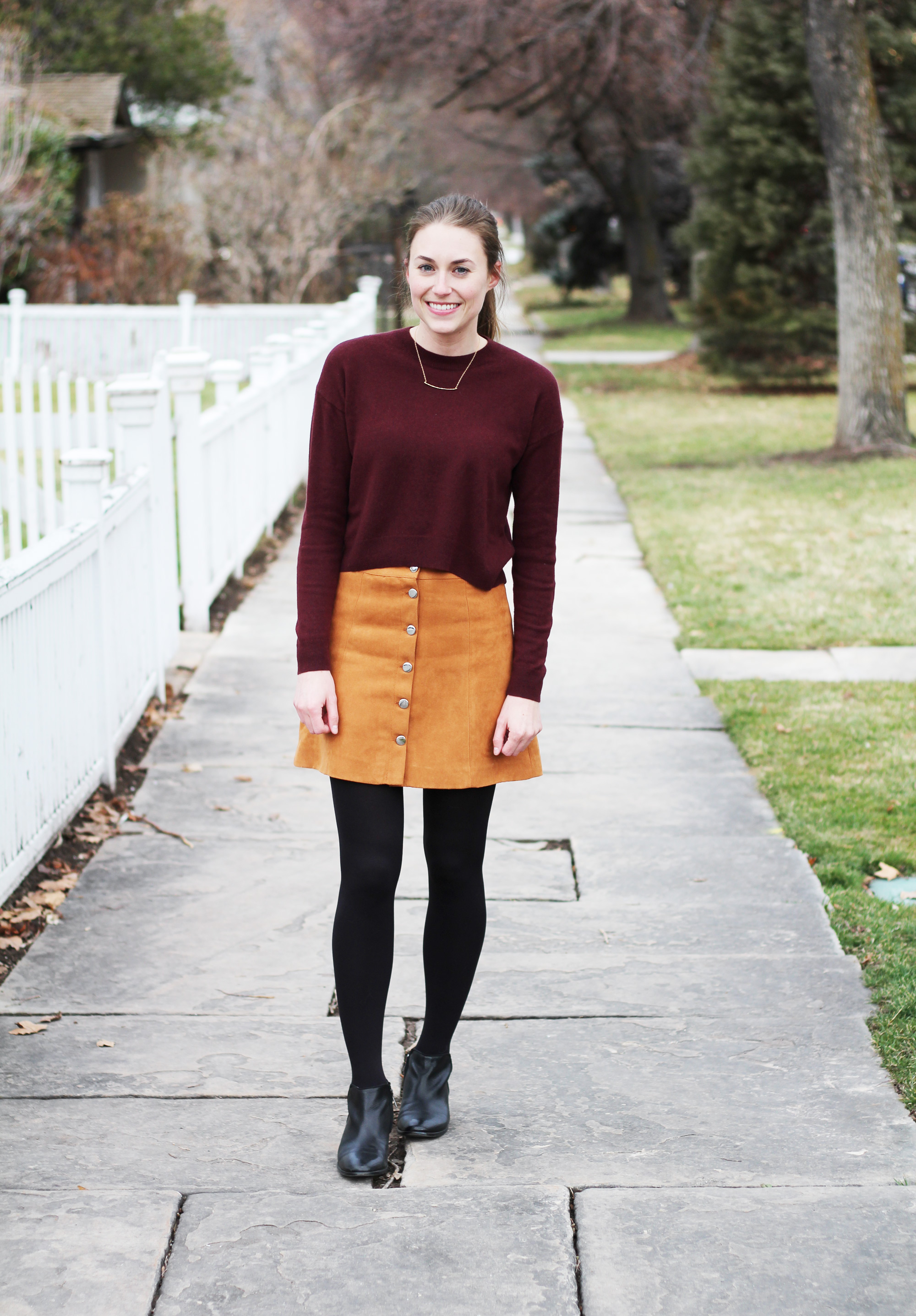 Burgundy cropped sweater outfit with tan button-front skirt and black ankle boots — Cotton Cashmere Cat Hair