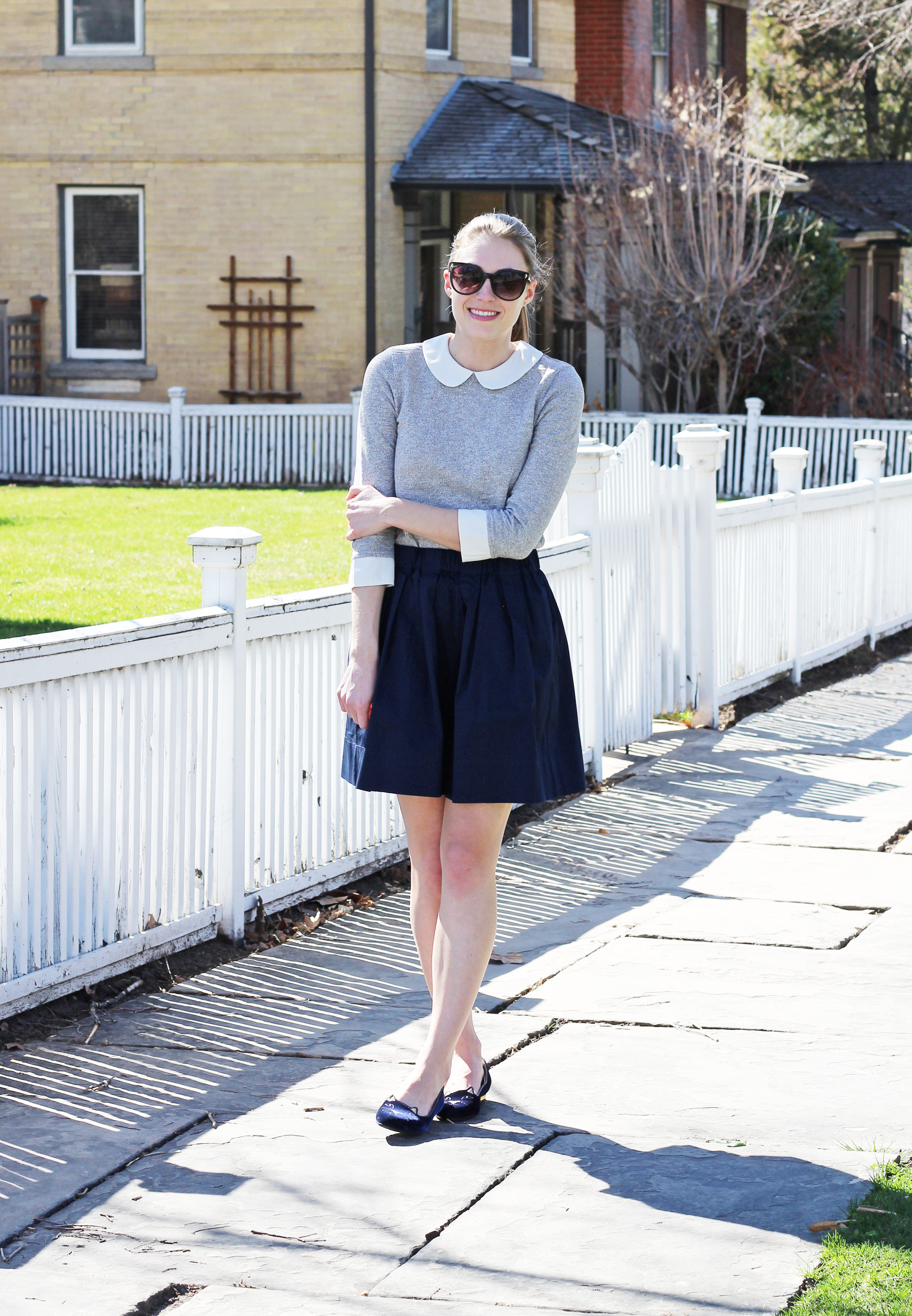 Spring outfit with grey top, navy mini skirt, Charlotte Olympia 'Kitty' flats — Cotton Cashmere Cat Hair