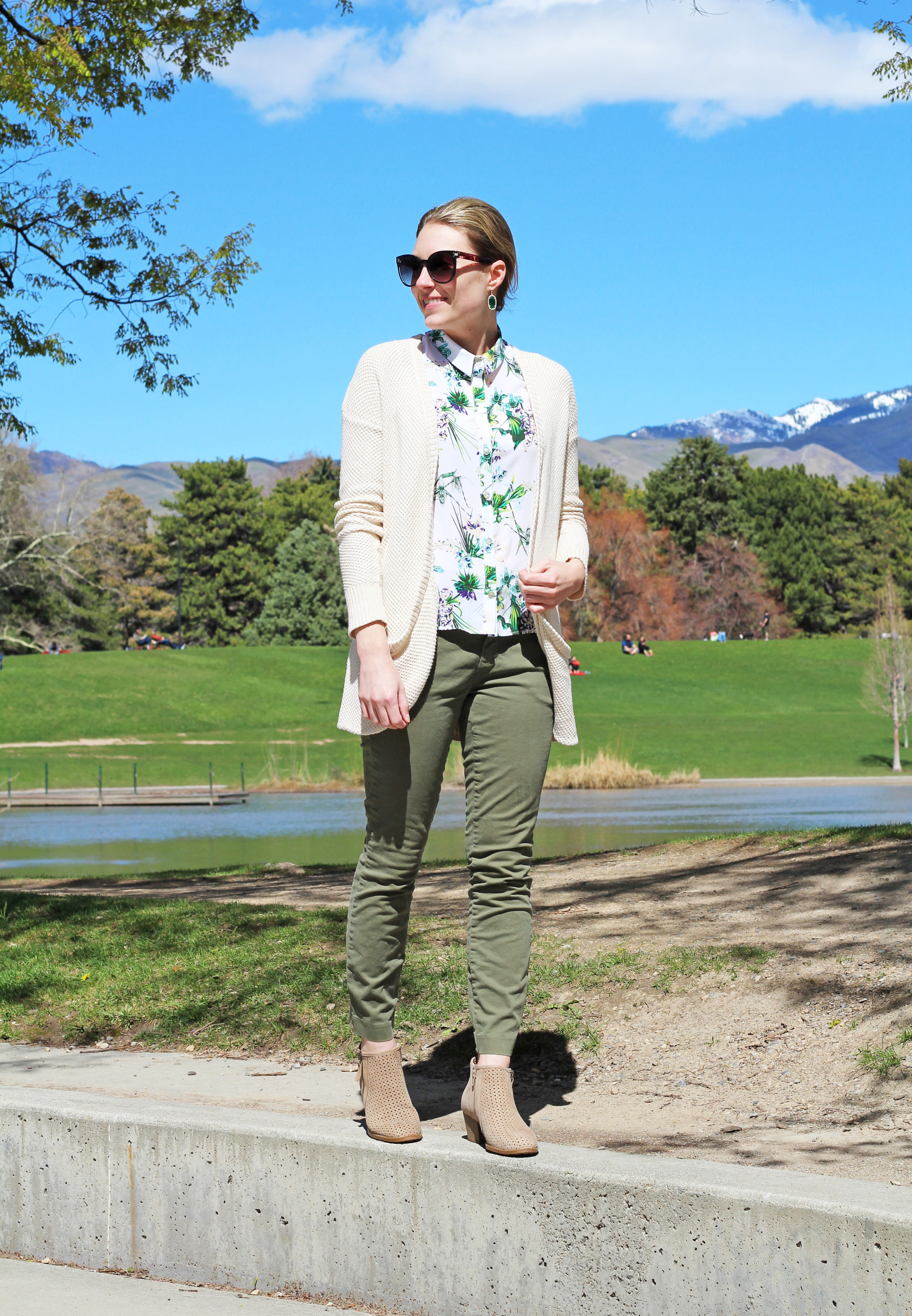 Spring outfit with cream cardigan, tropical print tank, army green chinos, taupe ankle boots — Cotton Cashmere Cat Hair
