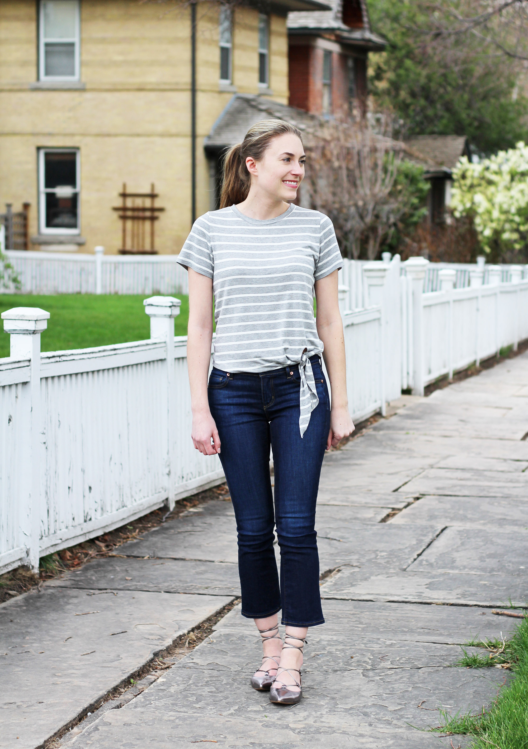 Spring outfit with side-tie tee, cropped flare jeans, lace-up flats — Cotton Cashmere Cat Hair