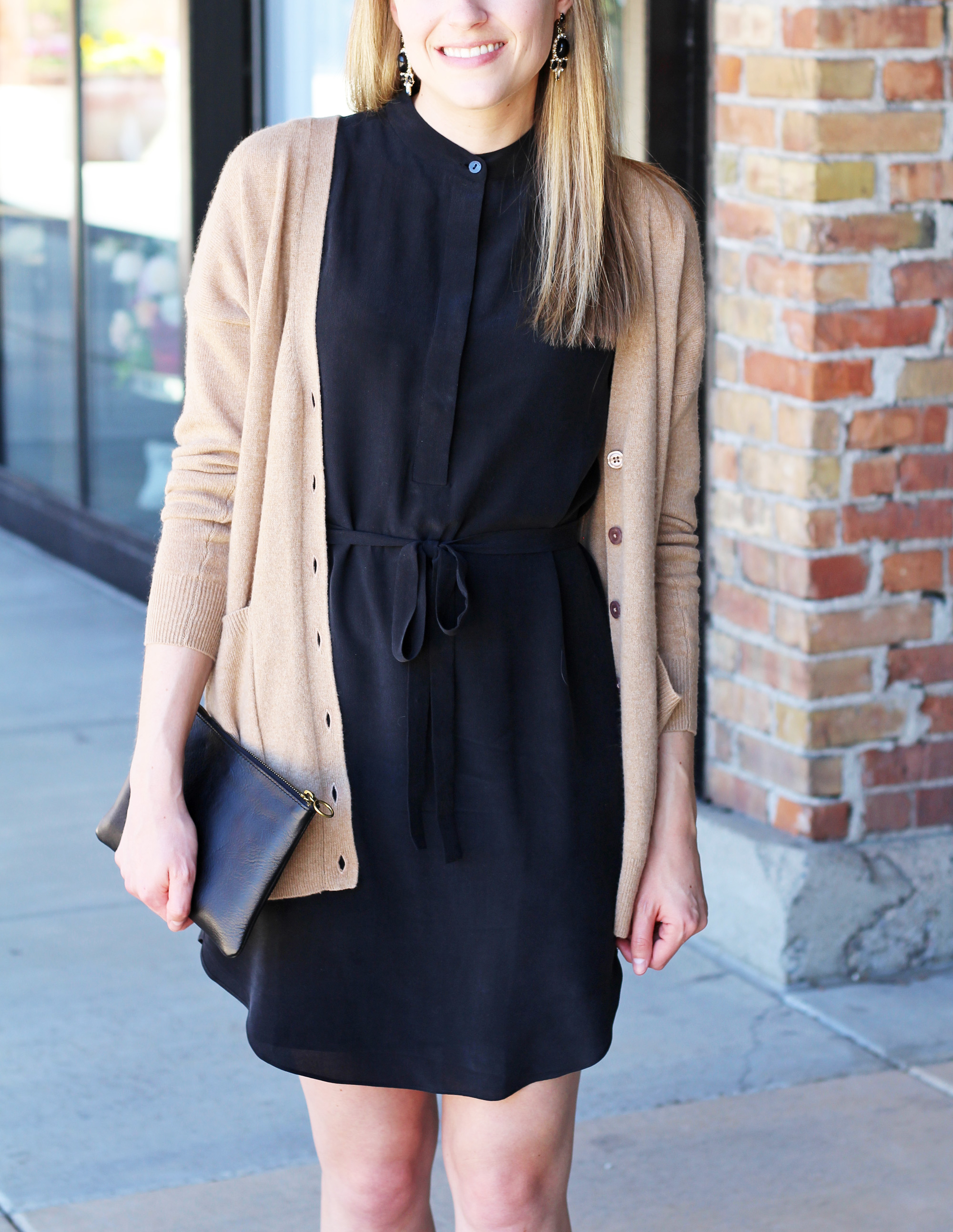 Black silk dress outfit with camel cardigan and statement earrings — Cotton Cashmere Cat Hair