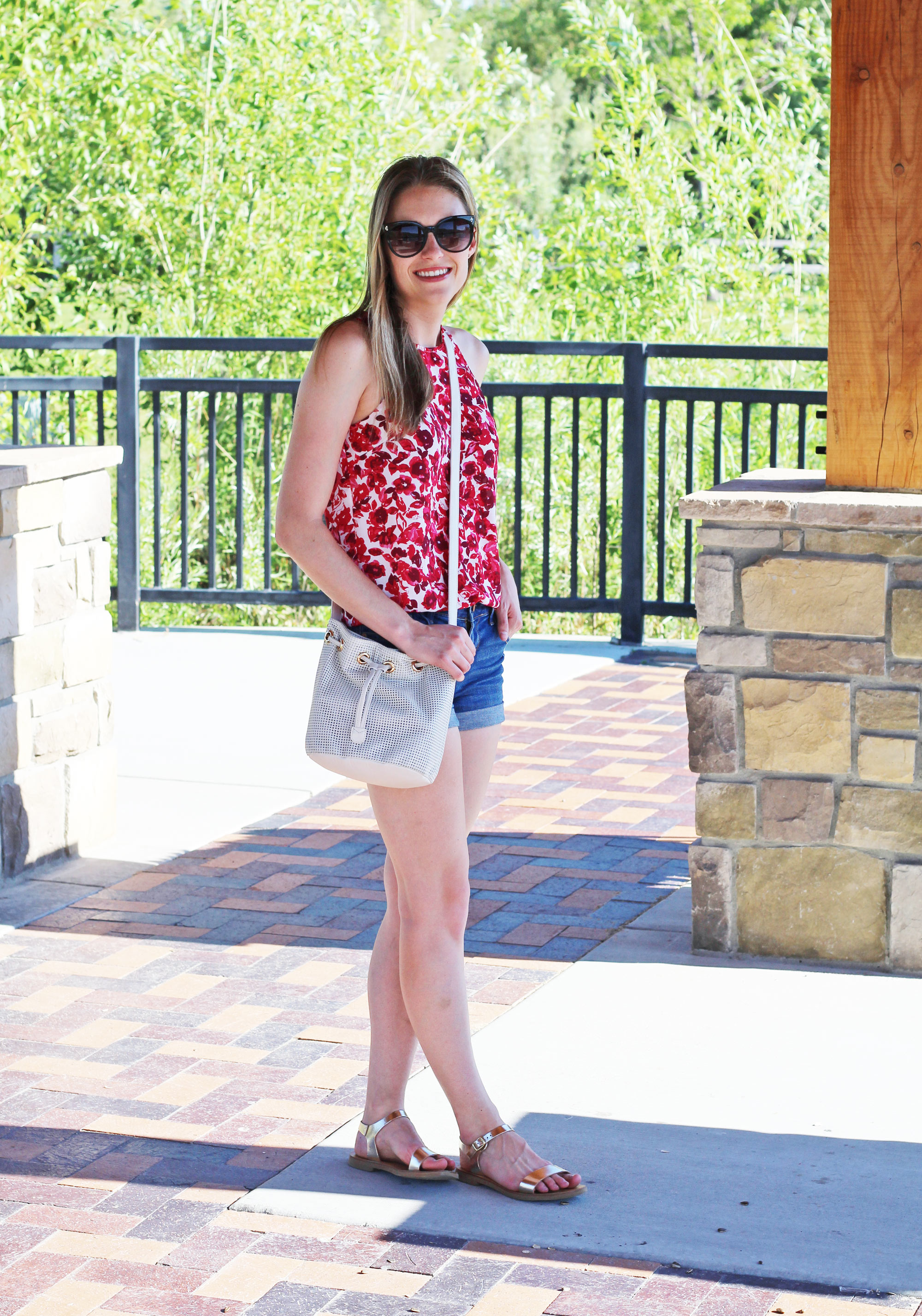 White leather bucket bag outfit with red floral top and gold sandals — Cotton Cashmere Cat Hair