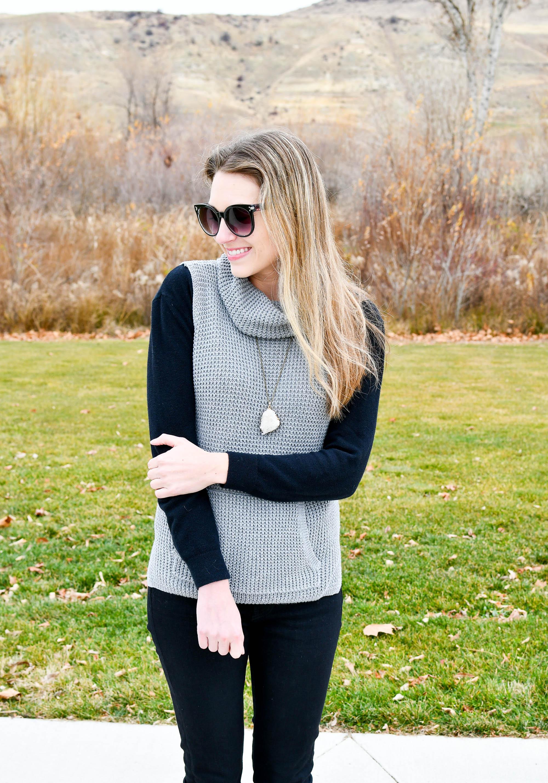 Sleeveless sweater worn over black sweater — Cotton Cashmere Cat Hair