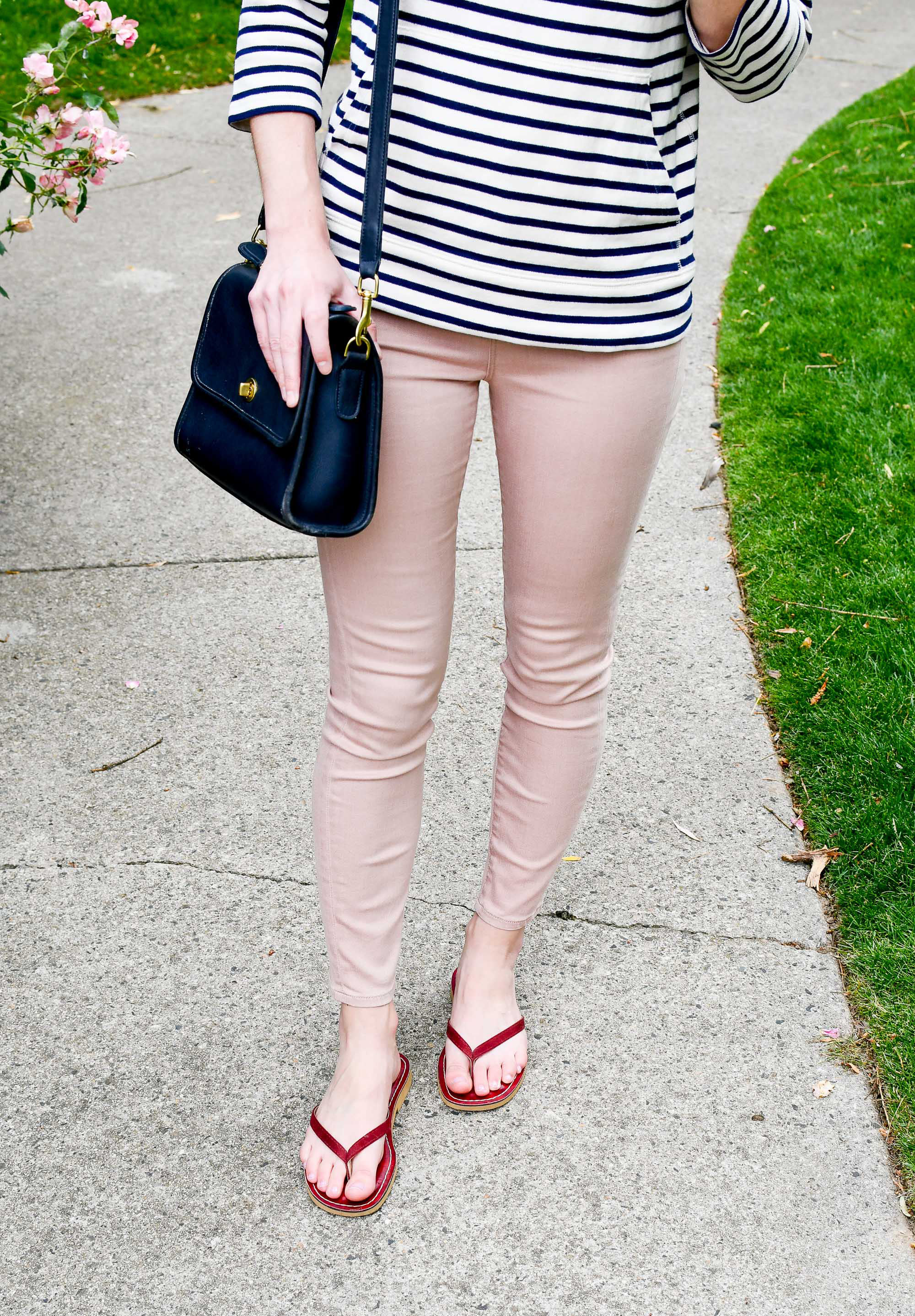 Pink denim outfit with navy bag and red sandals — Cotton Cashmere Cat Hair