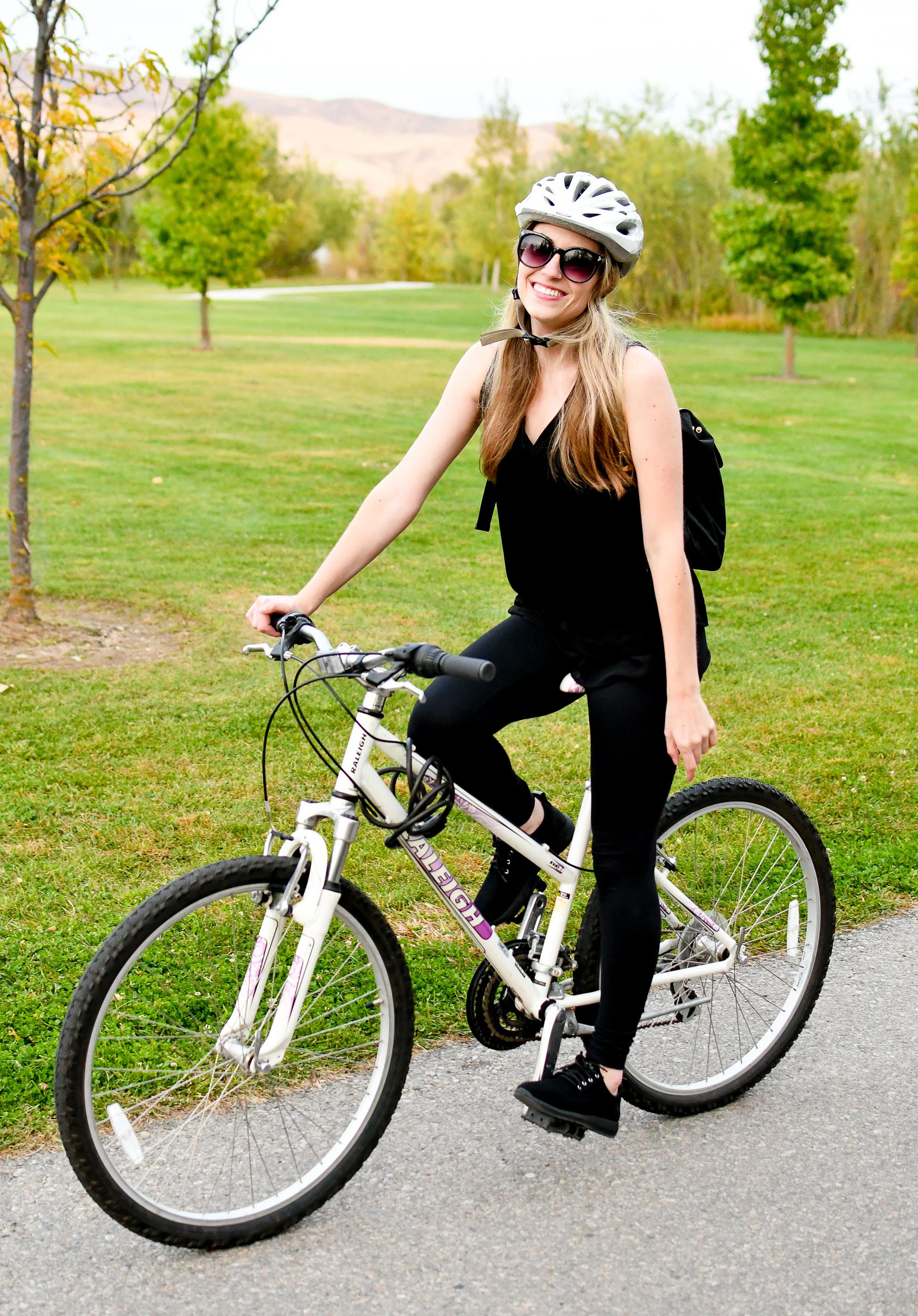 Bike riding in black Earth Boomer sneakers — Cotton Cashmere Cat Hair