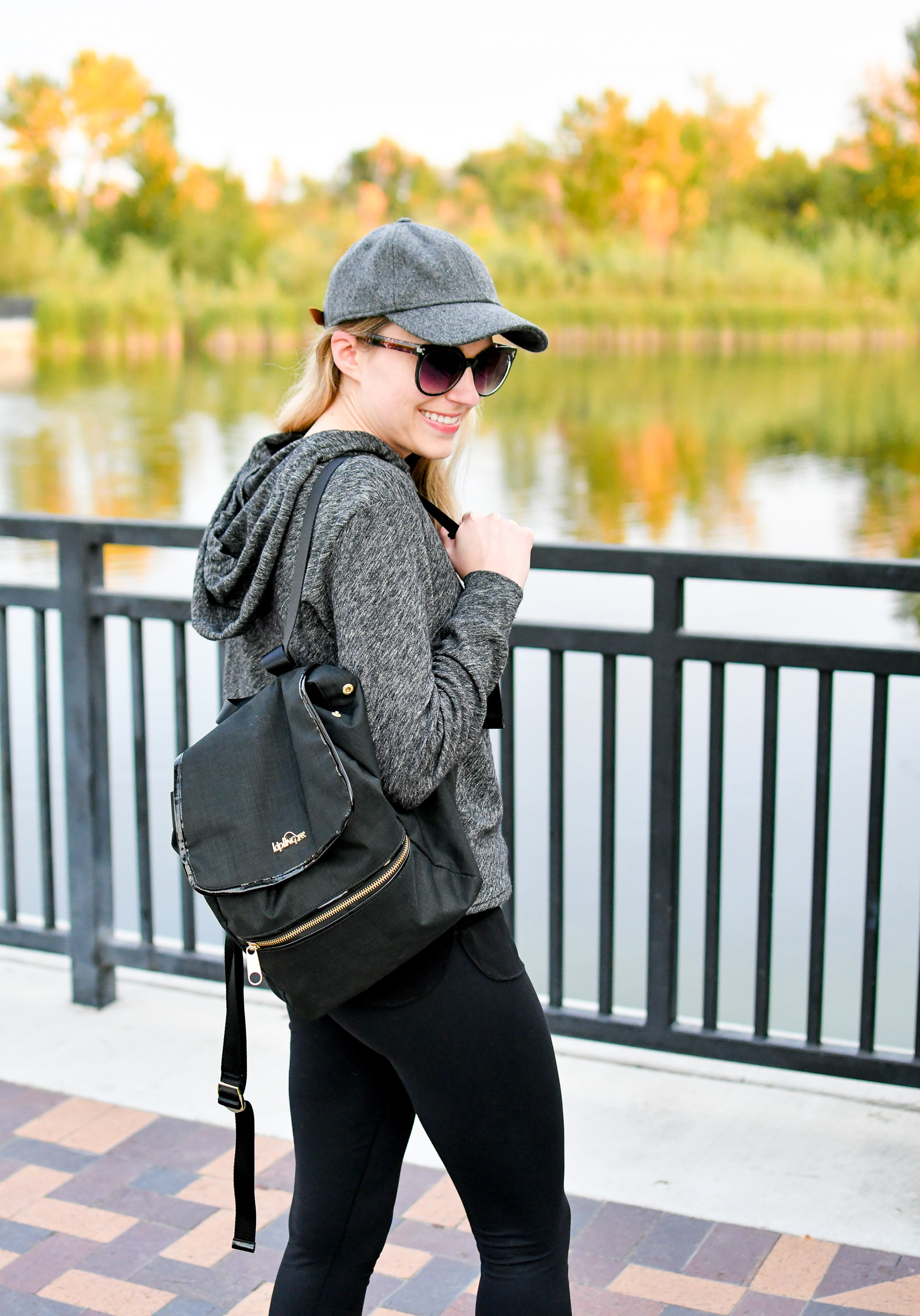 Black backpack fall outfit with grey baseball cap — Cotton Cashmere Cat Hair