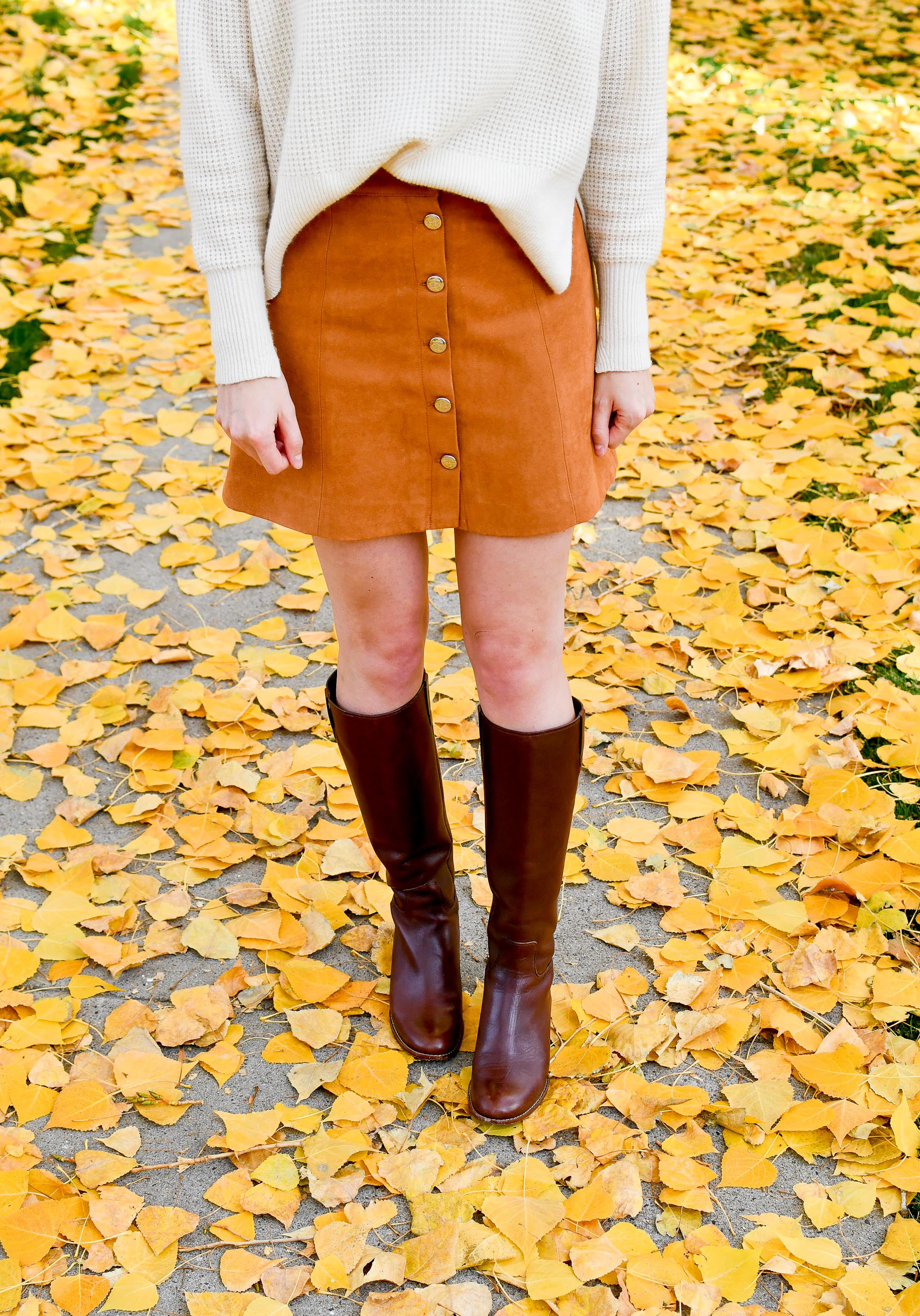 Fall outfit with ivory sweater, camel mini skirt, brown riding boots — Cotton Cashmere Cat Hair