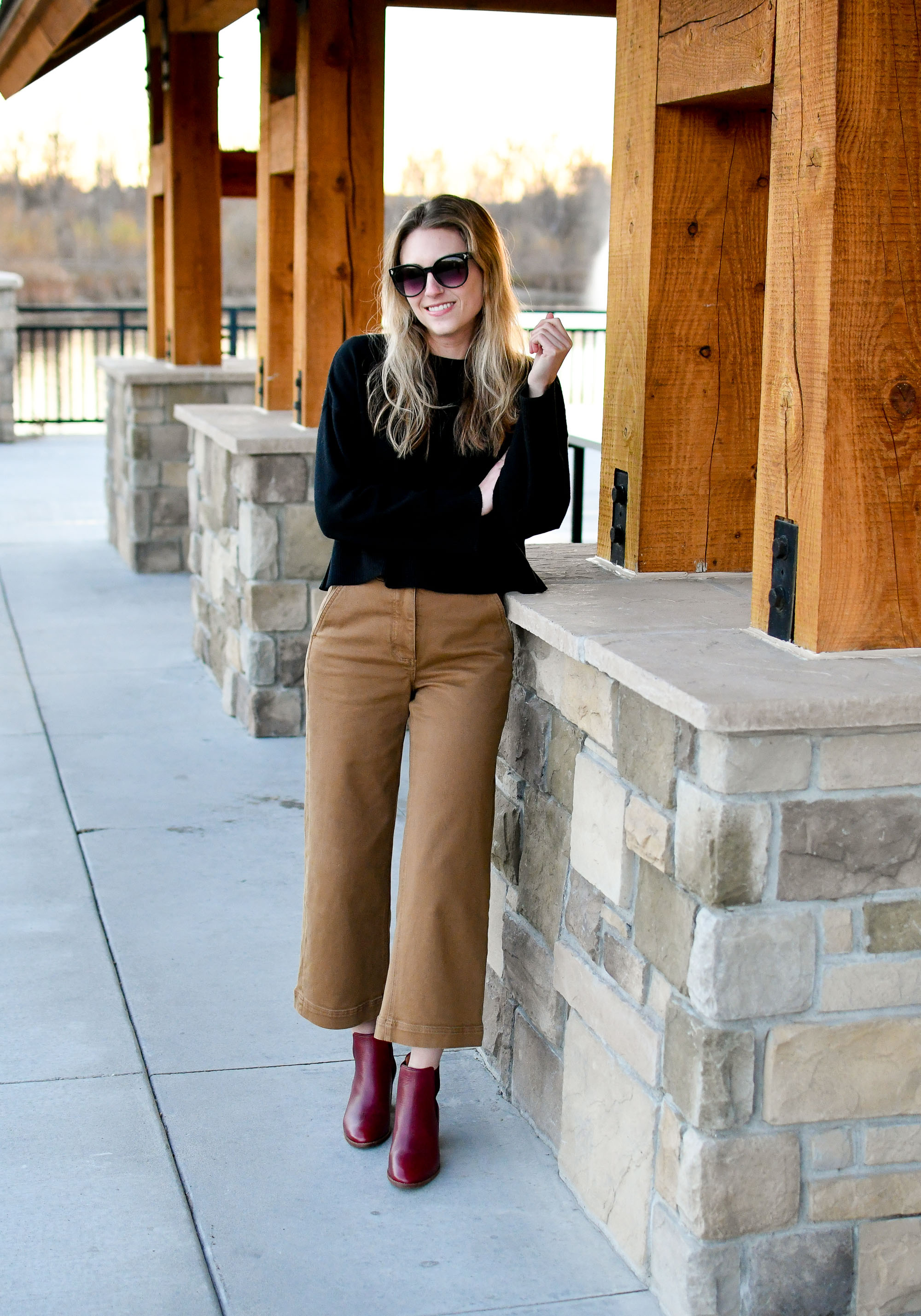 Fall outfit with black sweater, wide leg pants, burgundy ankle boots — Cotton Cashmere Cat Hair