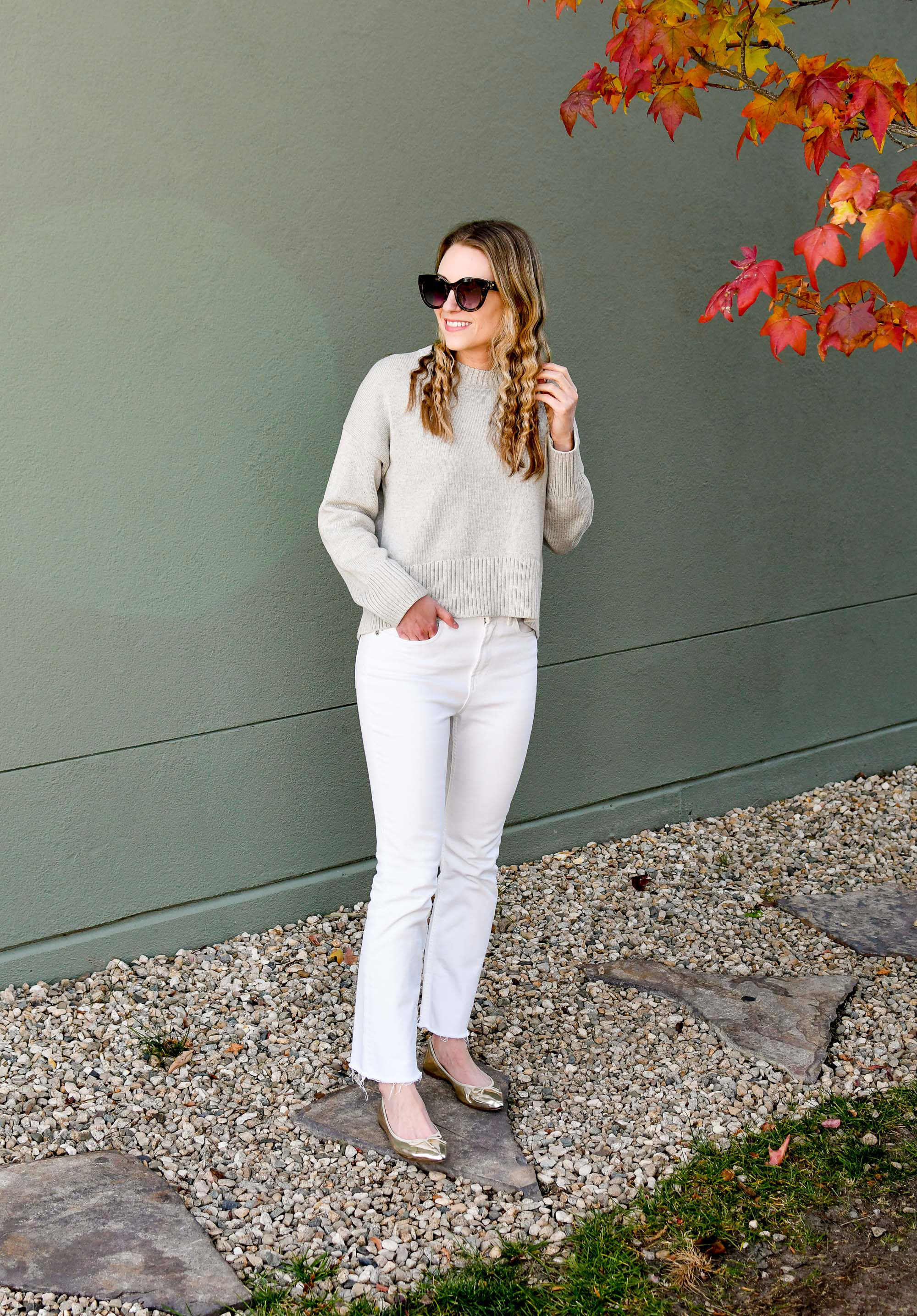 Casual holiday outfit with grey sweater, kick crop jeans, gold flats — Cotton Cashmere Cat Hair