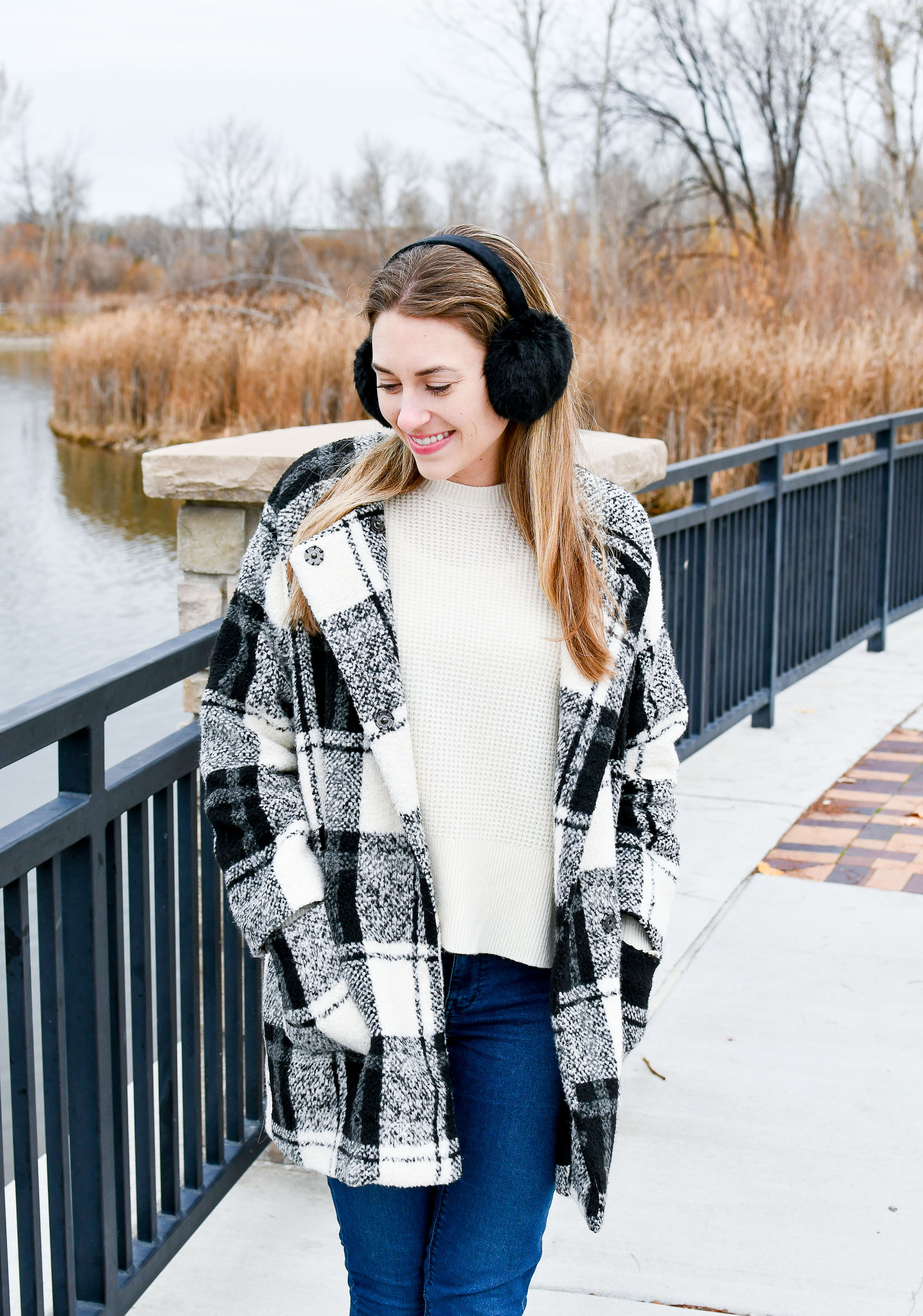 Cozy holiday outfit with black plaid coat and earmuffs — Cotton Cashmere Cat Hair
