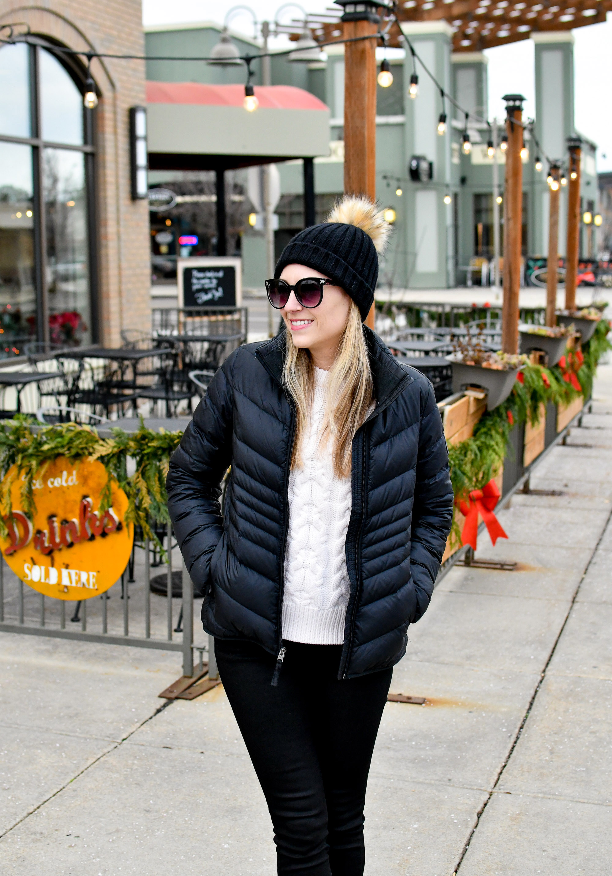 Black puffer coat winter outfit with black beanie — Cotton Cashmere Cat Hair
