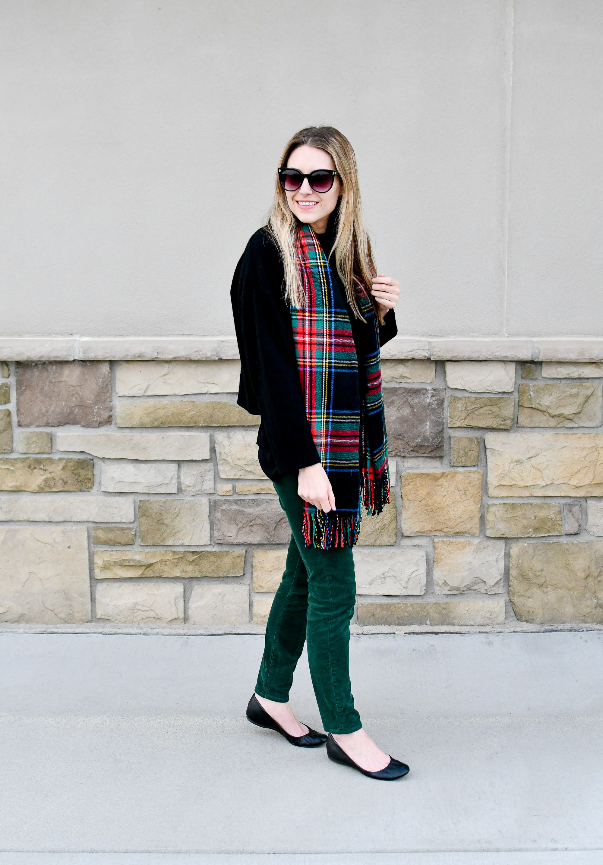 Tartan scarf, black cashmere sweater, green corduroy pants — Cotton Cashmere Cat Hair