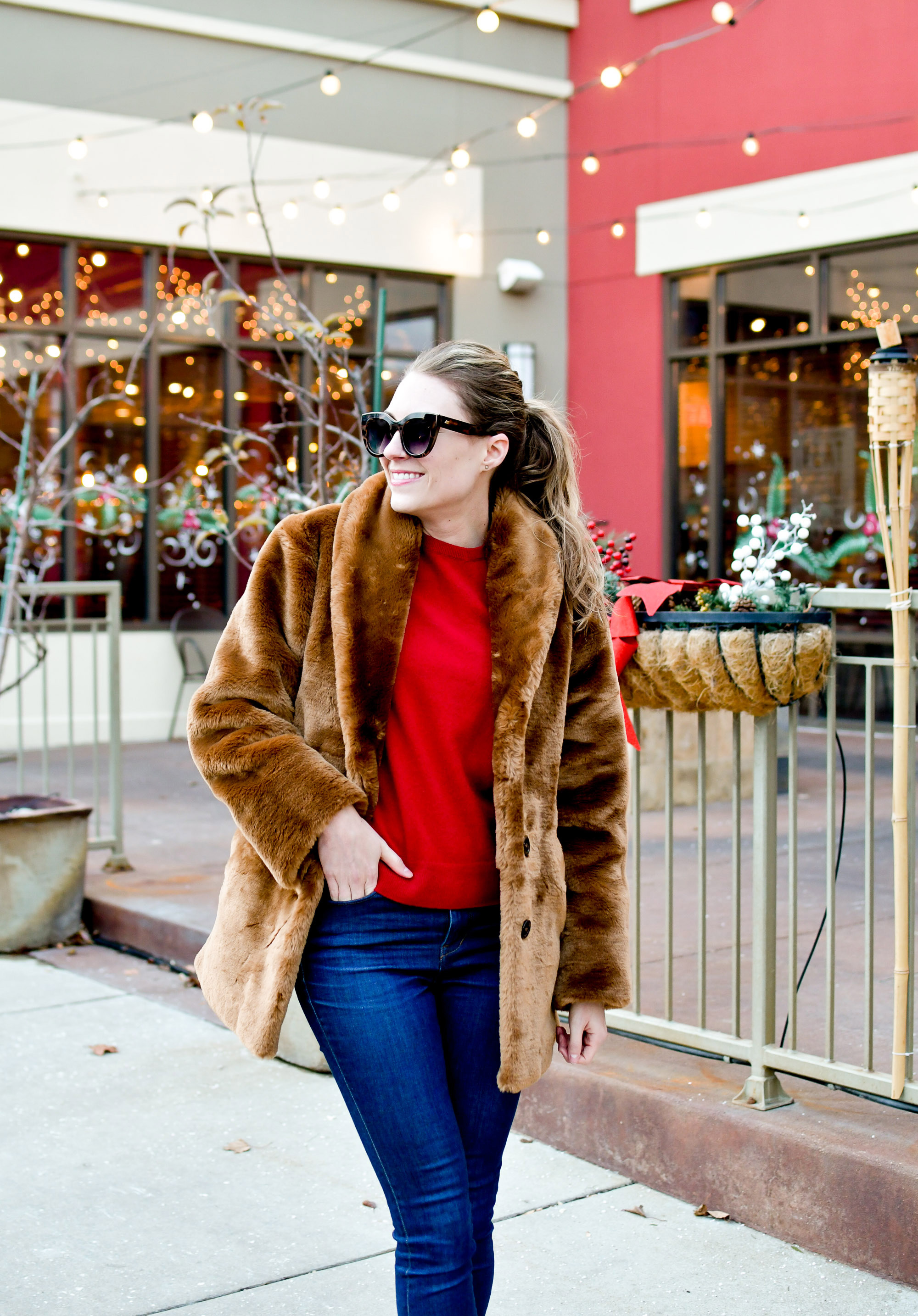 Brown faux fur coat holiday outfit with red cashmere sweater — Cotton Cashmere Cat Hair