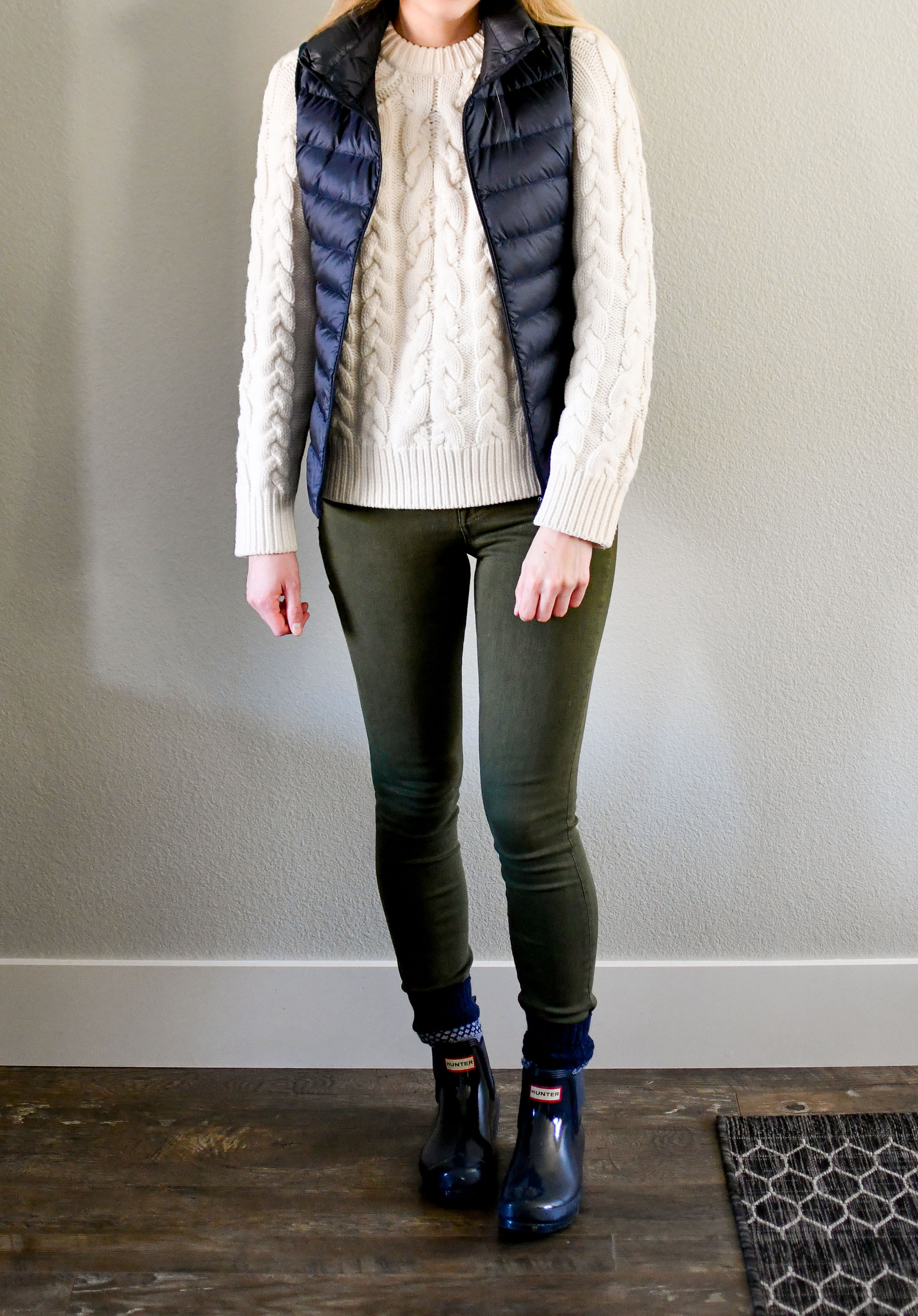 Navy vest, ivory sweater, olive green jeans, navy Hunter boots — Cotton Cashmere Cat Hair