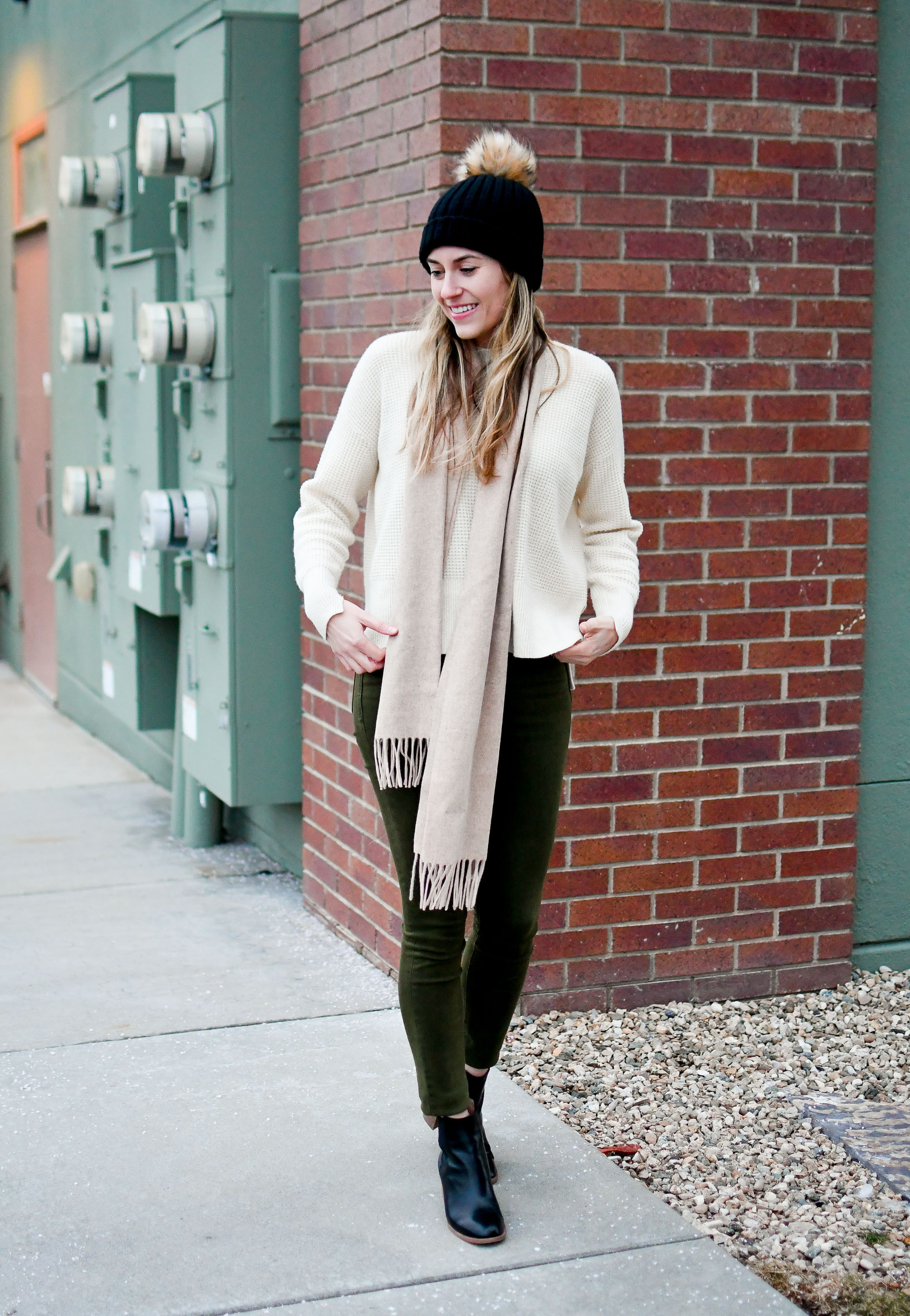 Black beanie, tan scarf, ivory sweater, olive green jeans, black ankle boots — Cotton Cashmere Cat Hair
