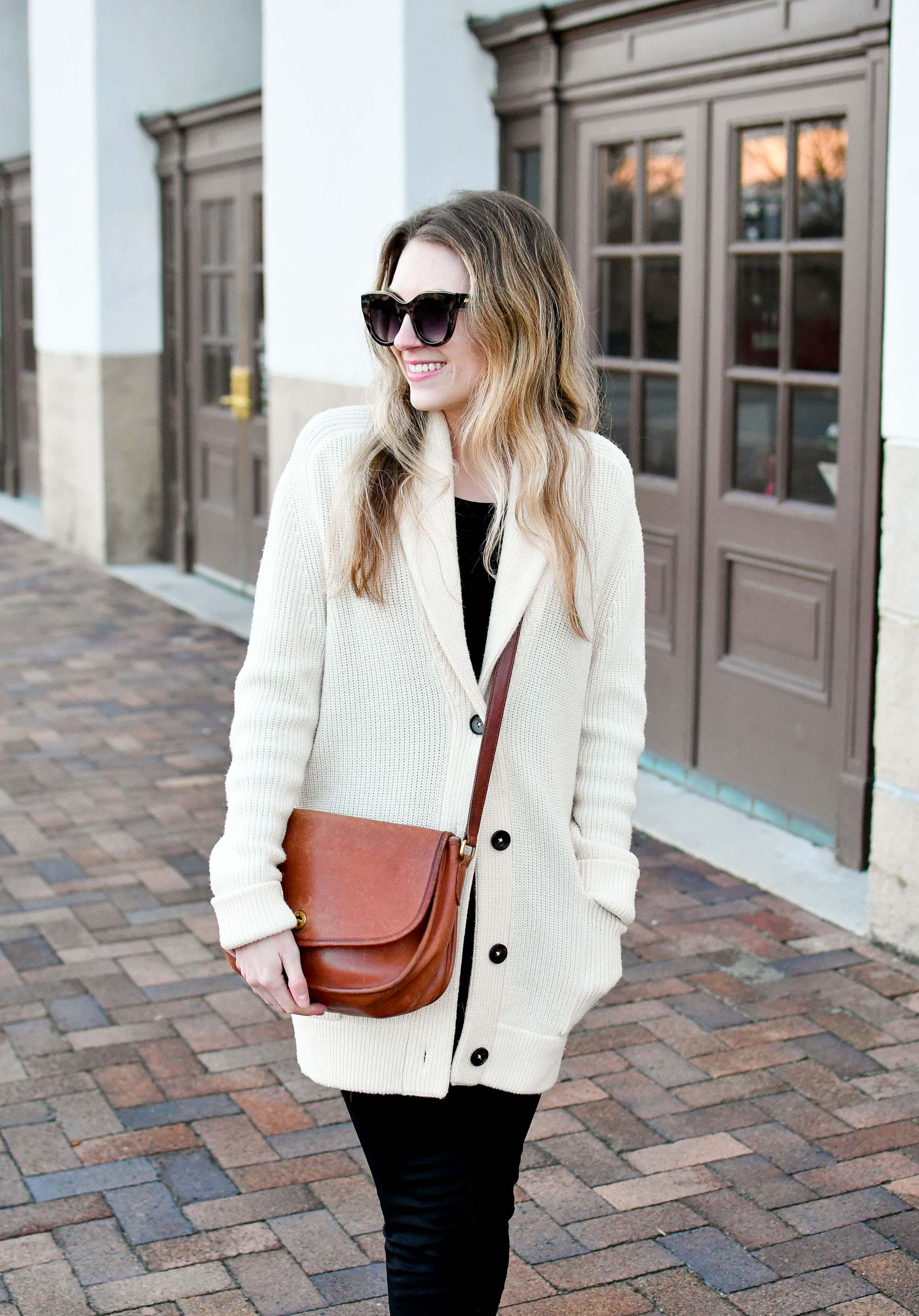 Chunky knit cardigan winter outfit with Coach City bag and black denim — Cotton Cashmere Cat Hair