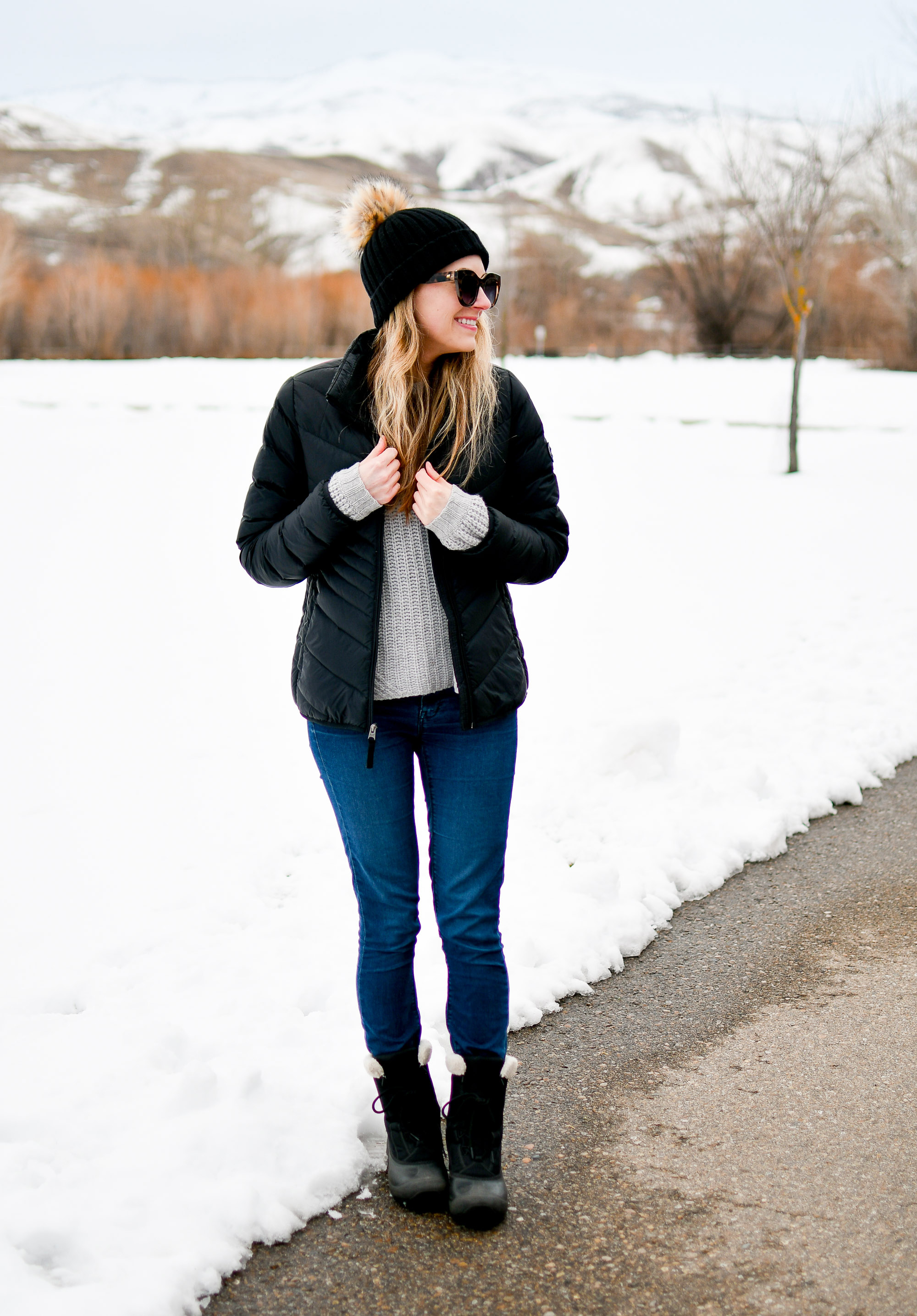 Black pom-pom beanie winter outfit with puffer coat and snow boots — Cotton Cashmere Cat Hair