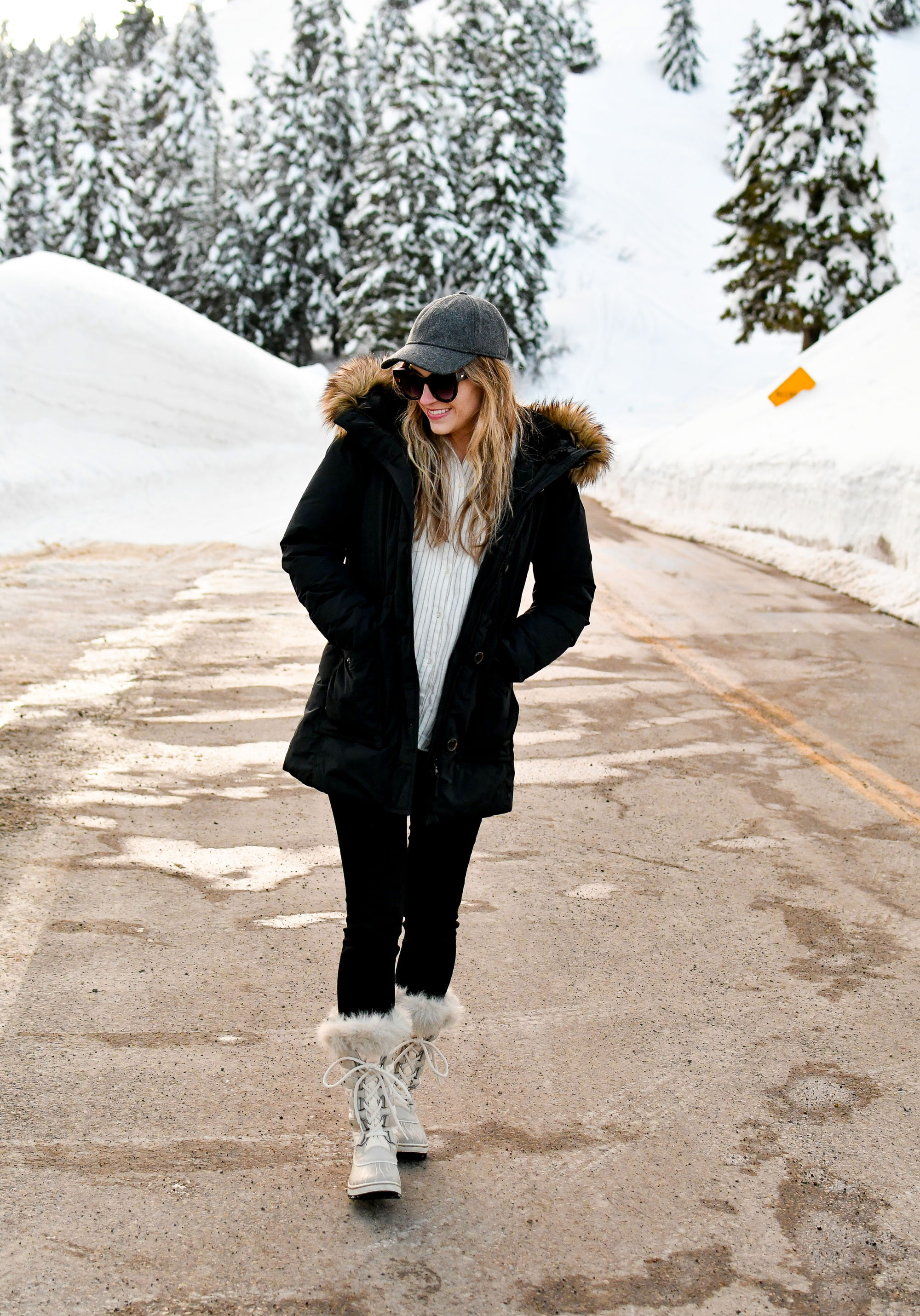 Black parka, flannel shirt, black denim, Sorel Tofino boots, grey baseball cap — Cotton Cashmere Cat Hair