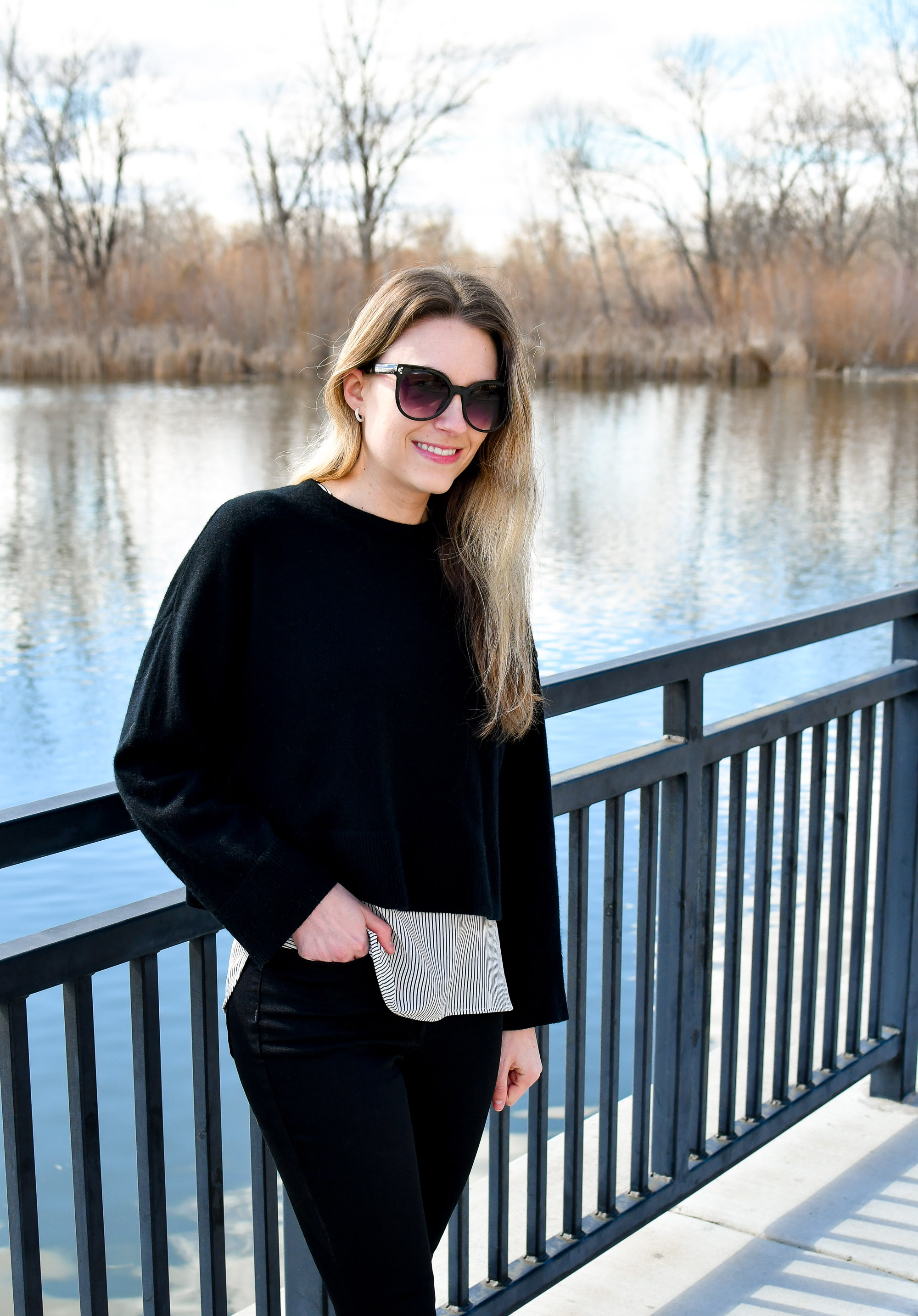 Black cropped cashmere sweater outfit with striped silk top — Cotton Cashmere Cat Hair
