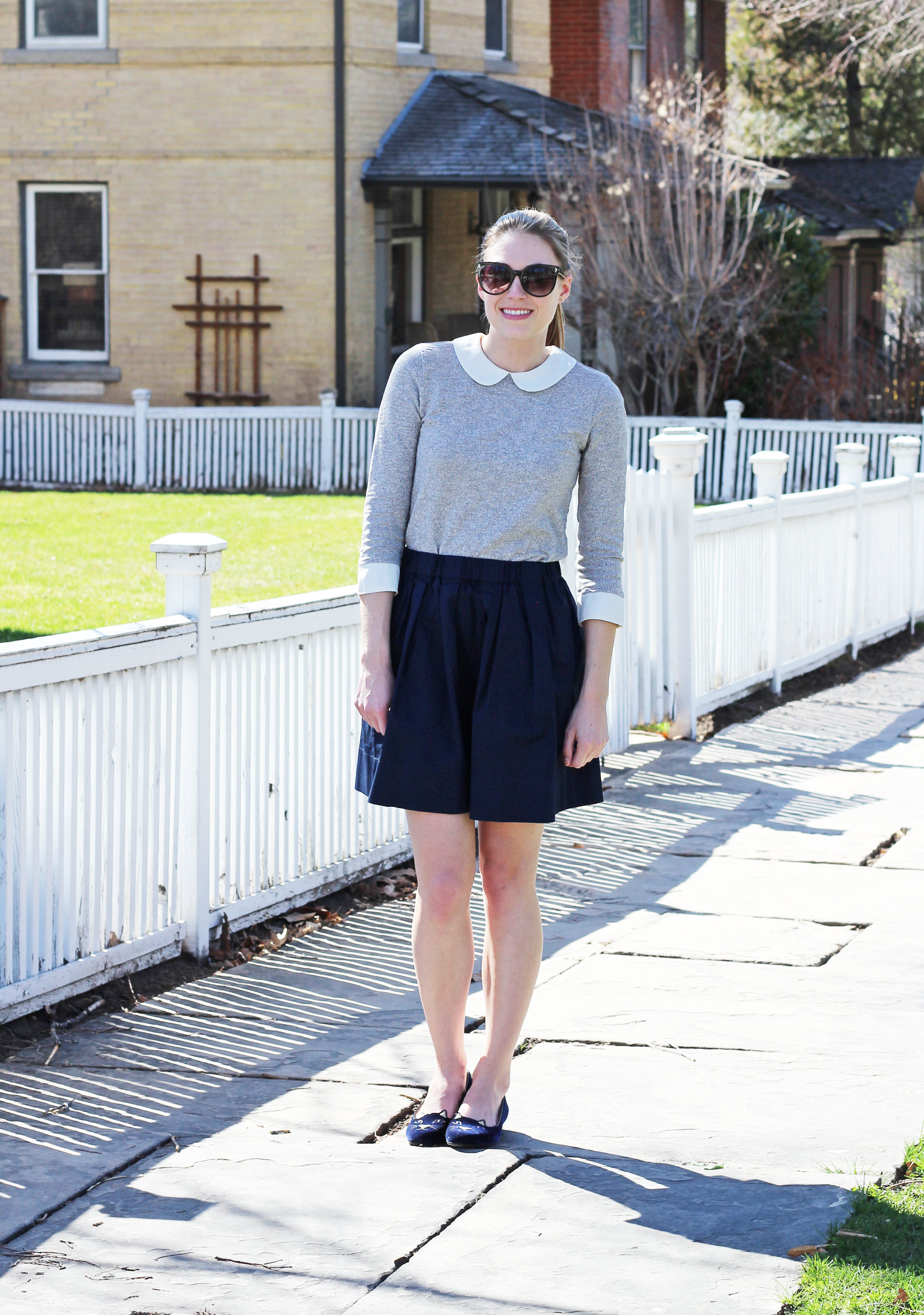 Spring outfit with Peter Pan collared top, navy skirt, Charlotte Olympia Kitty flats — Cotton Cashmere Cat Hair