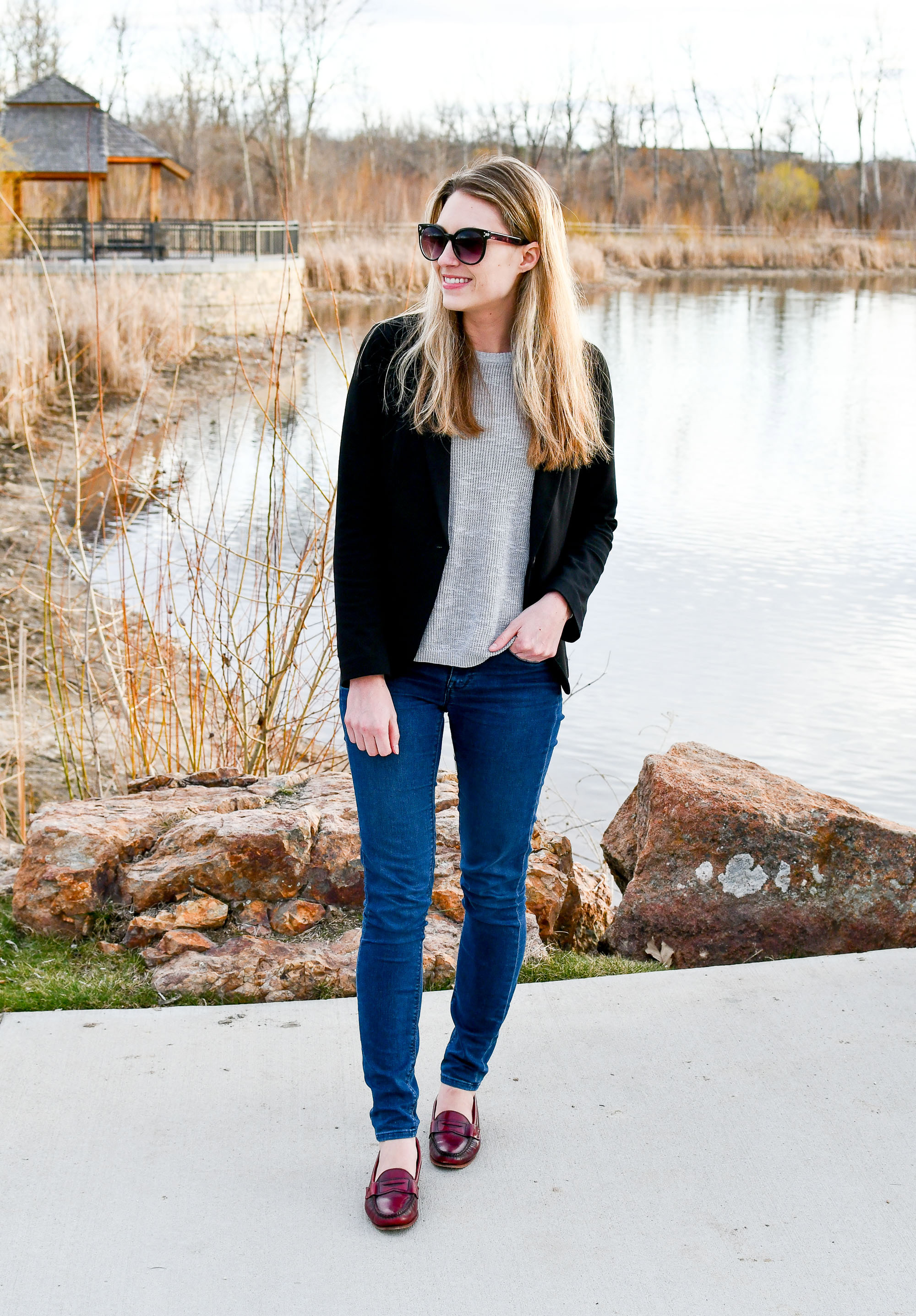 Spring work outfit with black blazer, grey sweater, red loafers — Cotton Cashmere Cat Hair