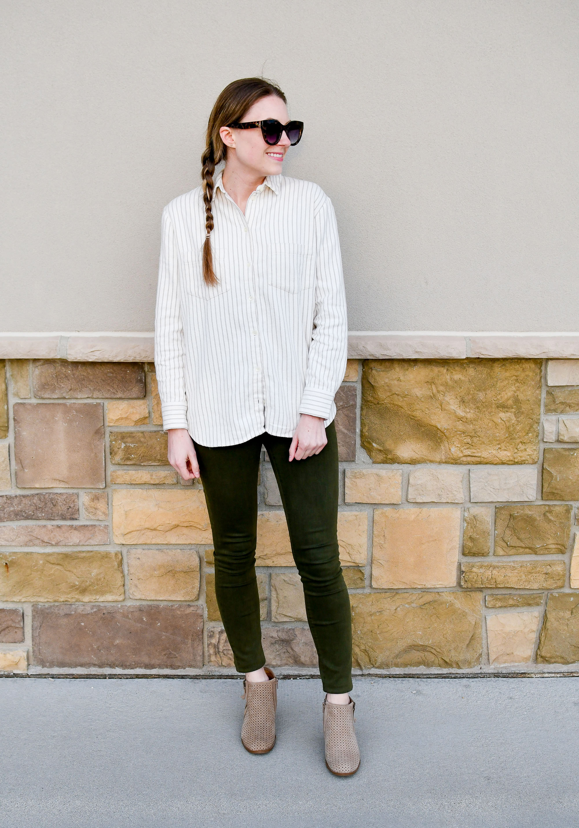Olive green skinny jeans spring outfit with striped flannel shirt and tan ankle boots — Cotton Cashmere Cat Hair