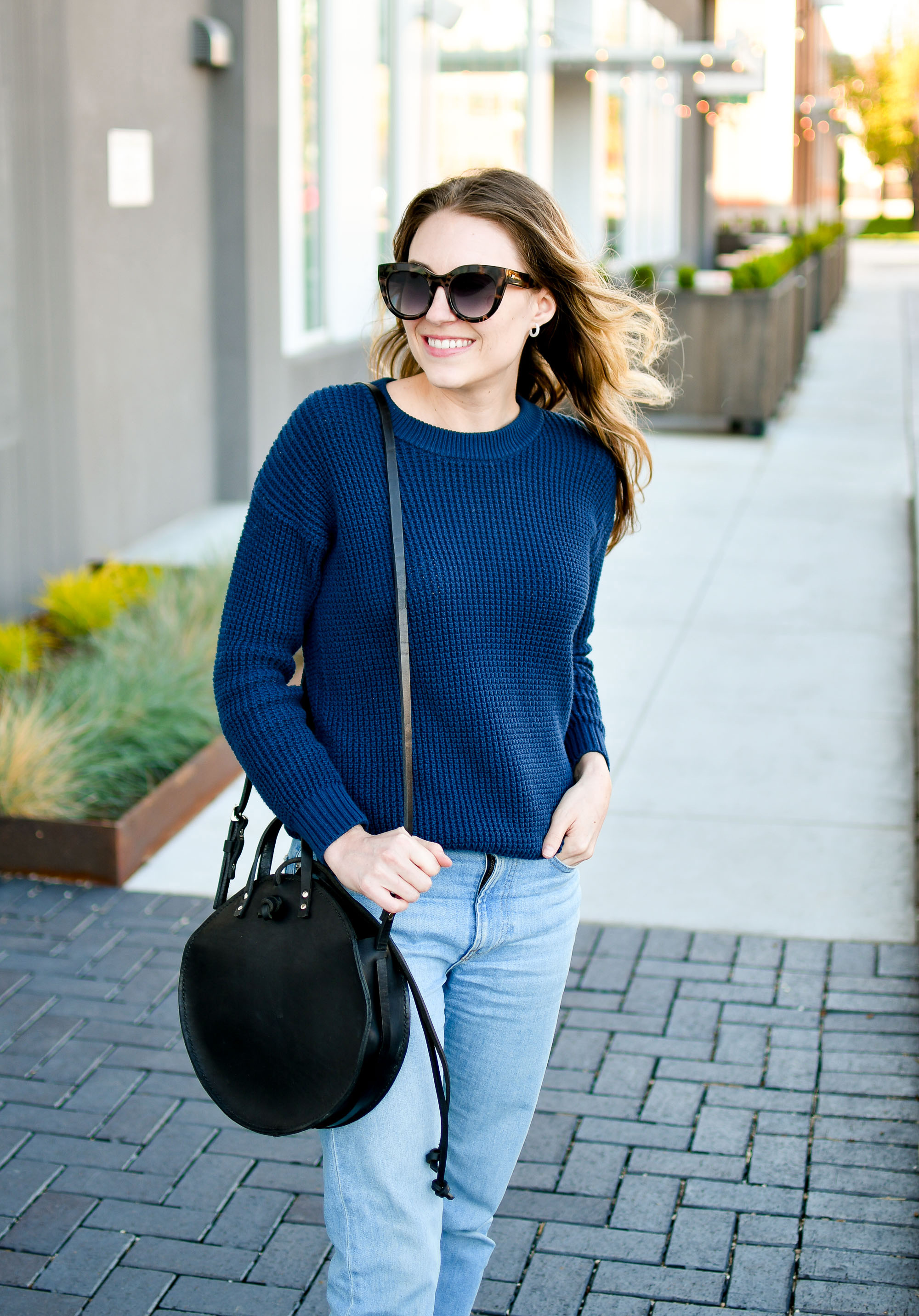 Navy sweater casual spring outfit with black bag — Cotton Cashmere Cat Hair