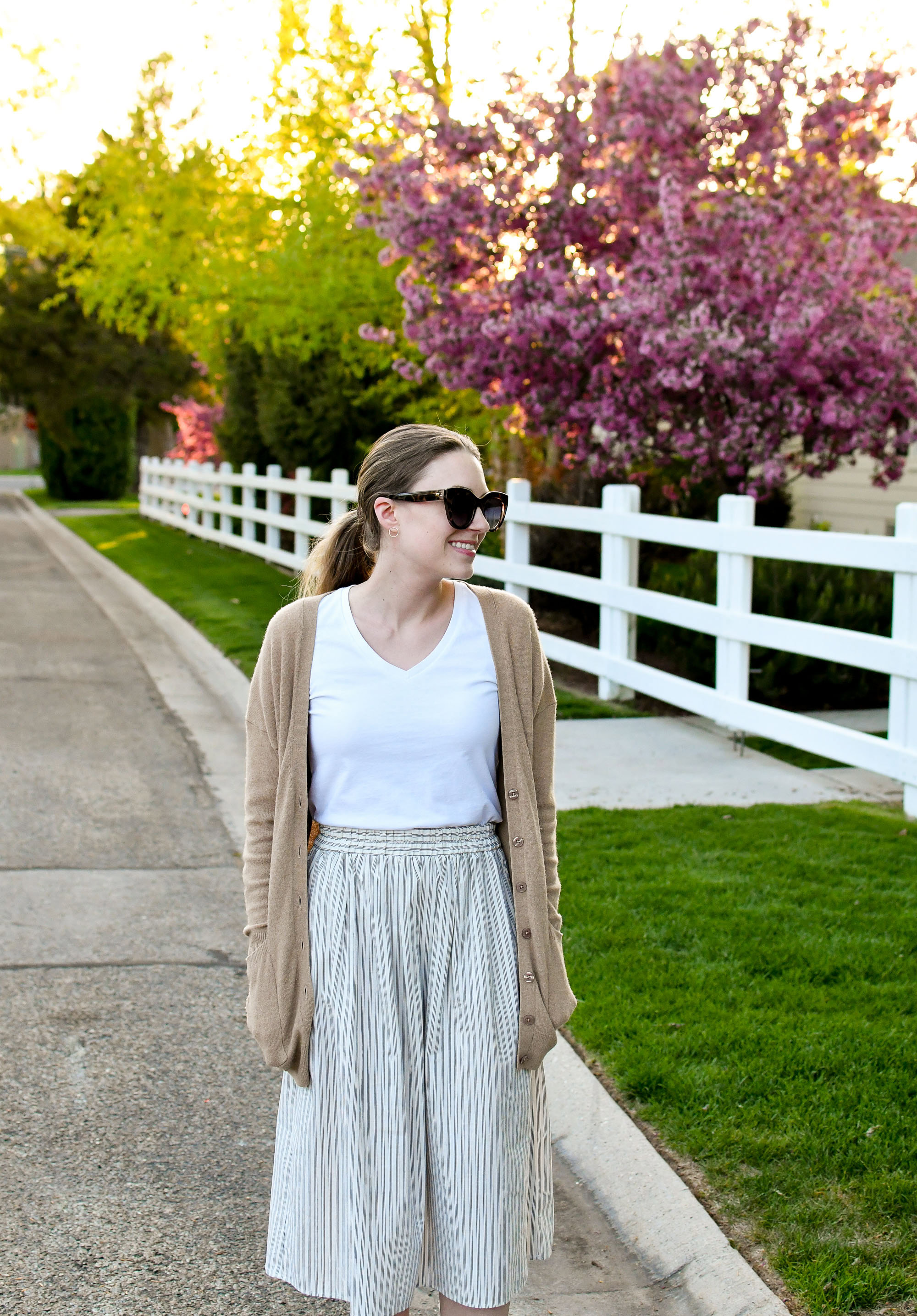 Camel cardigan spring outfit with white tee and striped skirt — Cotton Cashmere Cat Hair