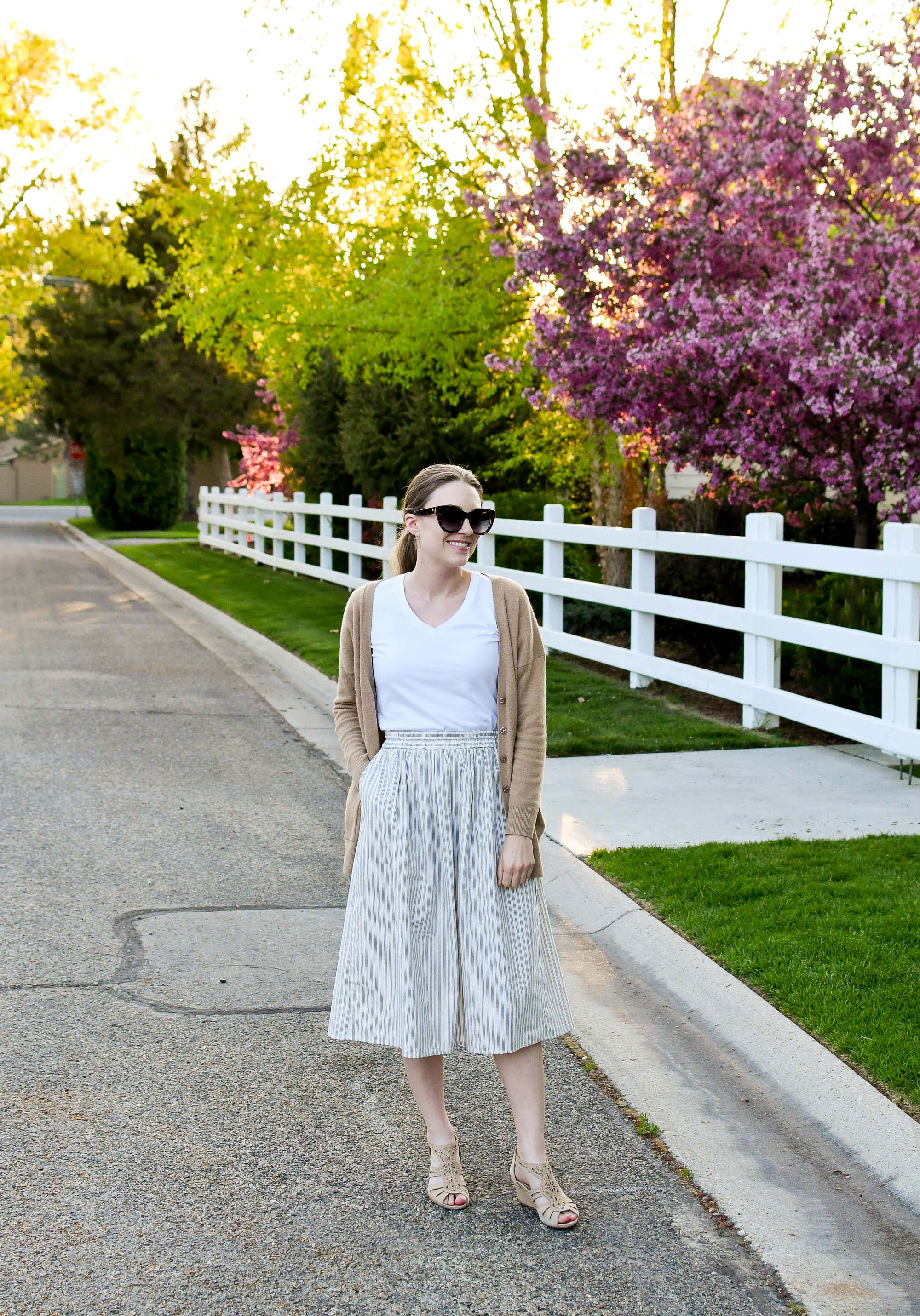 Spring midi skirt work outfit with white tee and camel cardigan — Cotton Cashmere Cat Hair