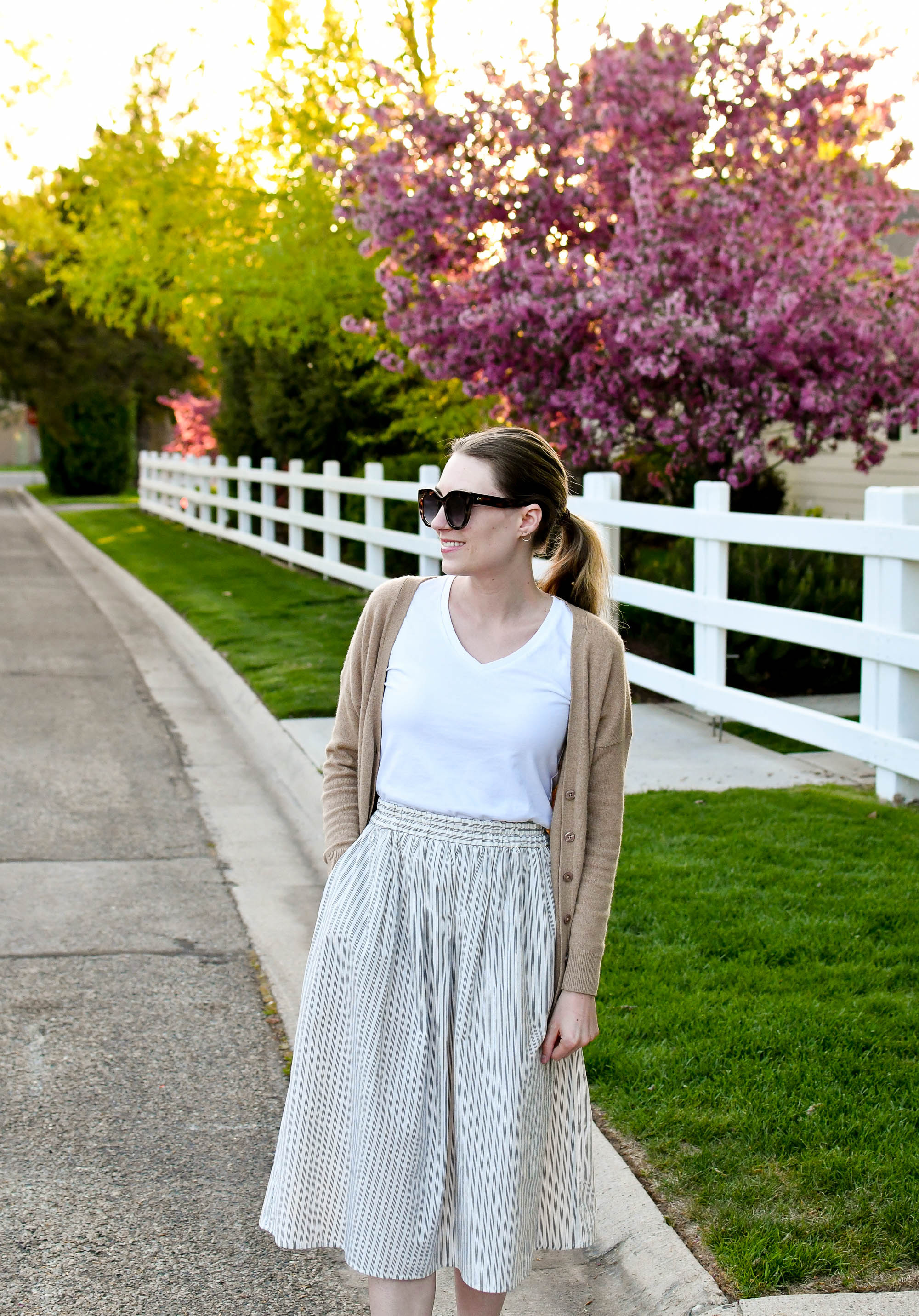 Camel cardigan, white tee, striped midi skirt spring outfit — Cotton Cashmere Cat Hair