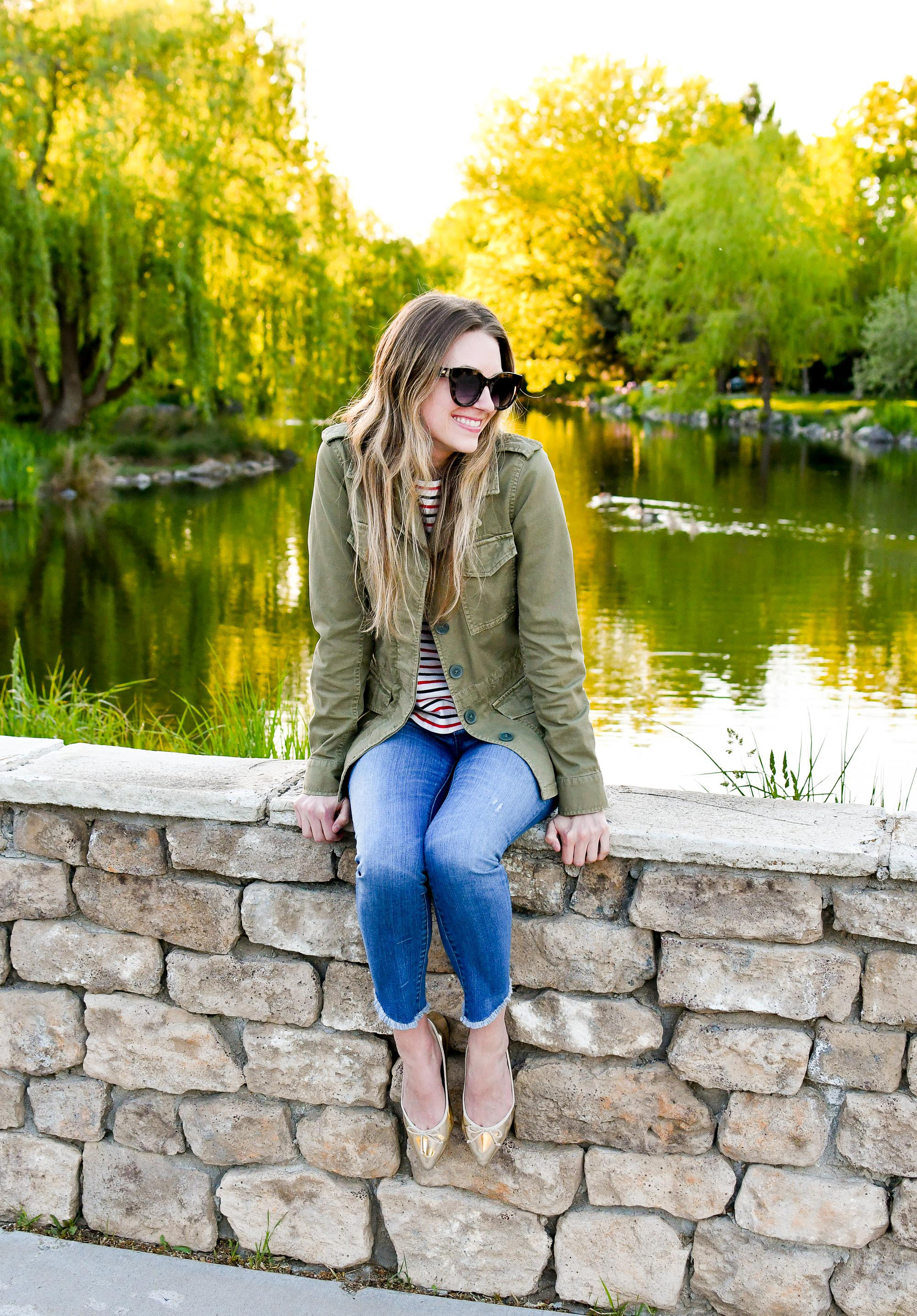 Casual spring outfit with army green utility jacket, skinny jeans, gold flats — Cotton Cashmere Cat Hair