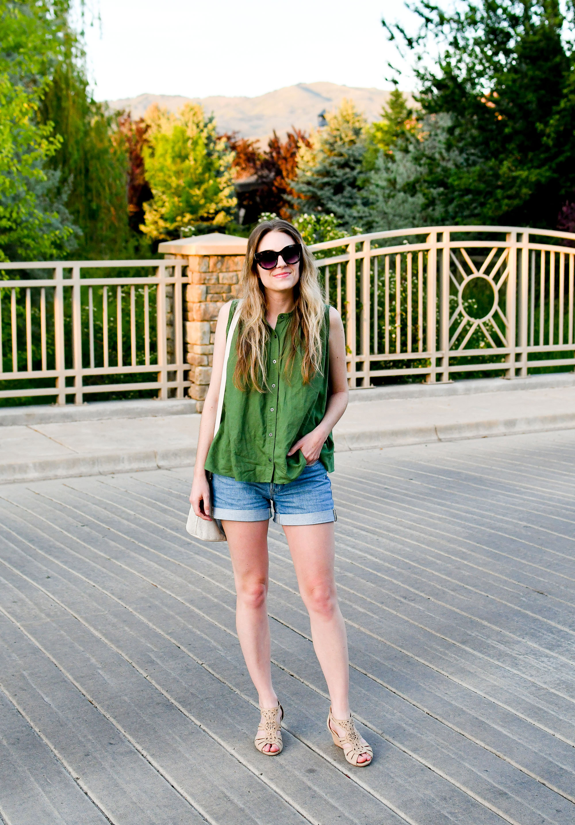 Green linen blend sleeveless top spring outfit with denim shorts and beige sandals — Cotton Cashmere Cat Hair