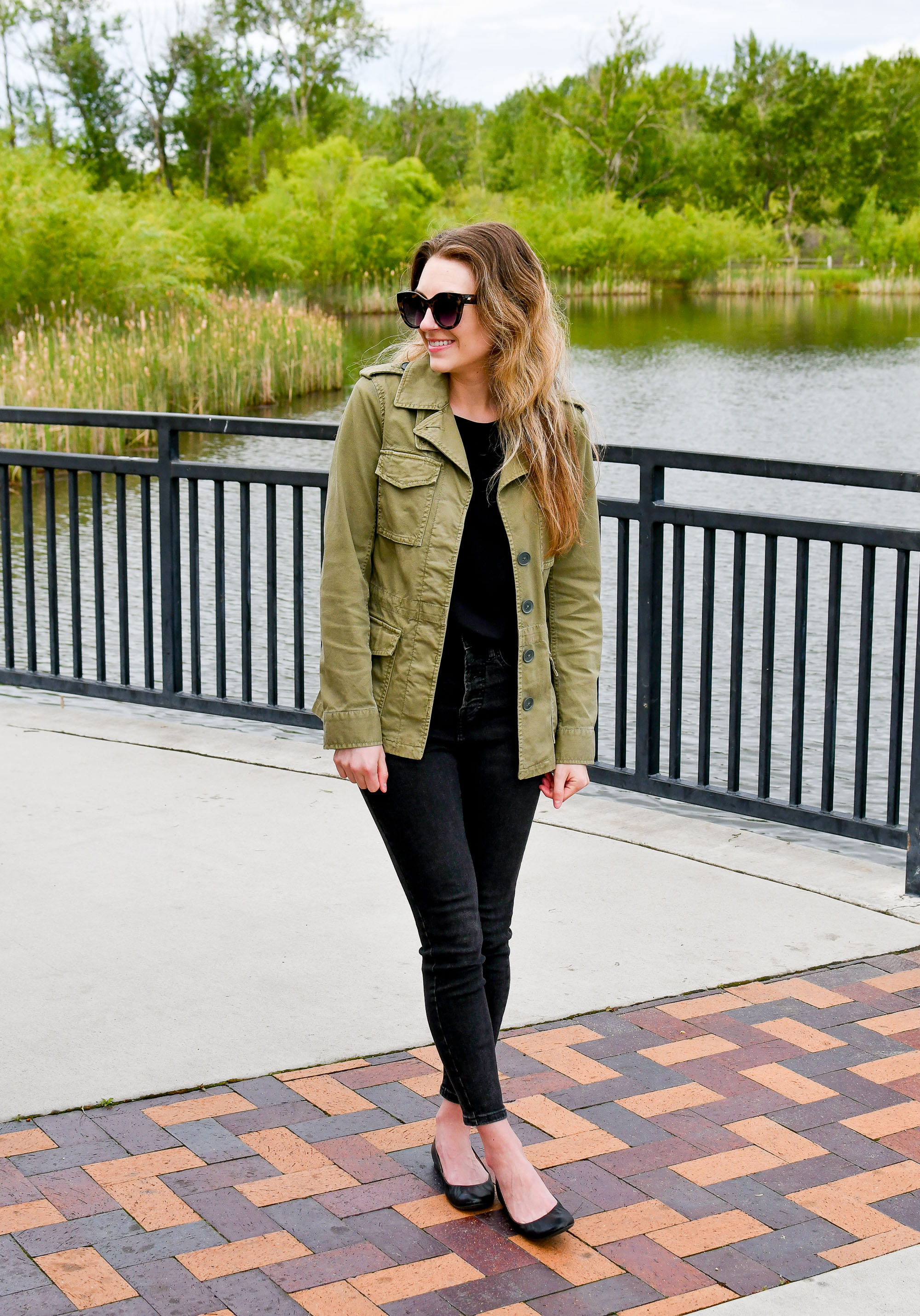 Casual spring outfit with green jacket, black tee, washed black jeans, black flats — Cotton Cashmere Cat Hair