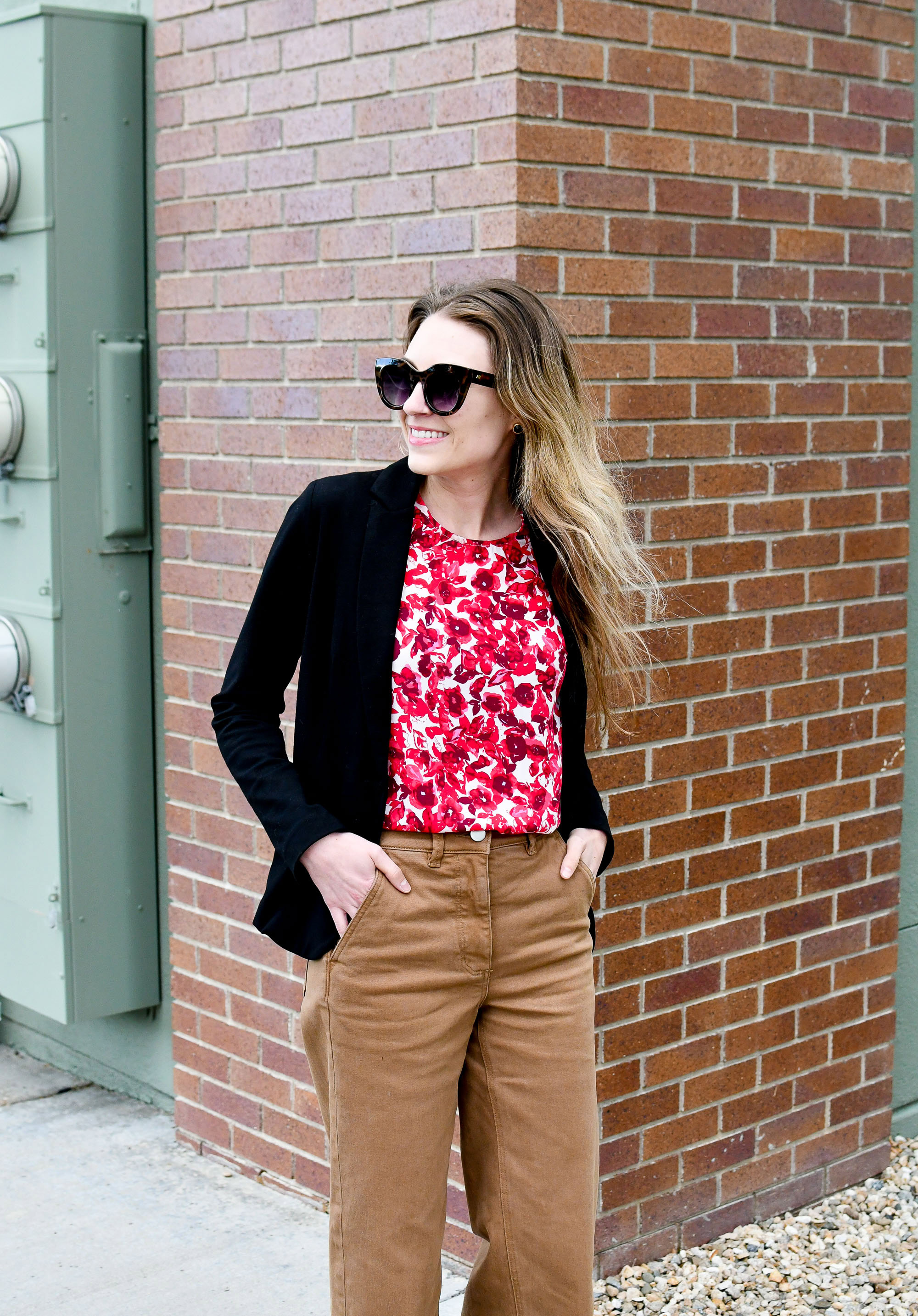Spring work outfit with black blazer and red floral top — Cotton Cashmere Cat Hair