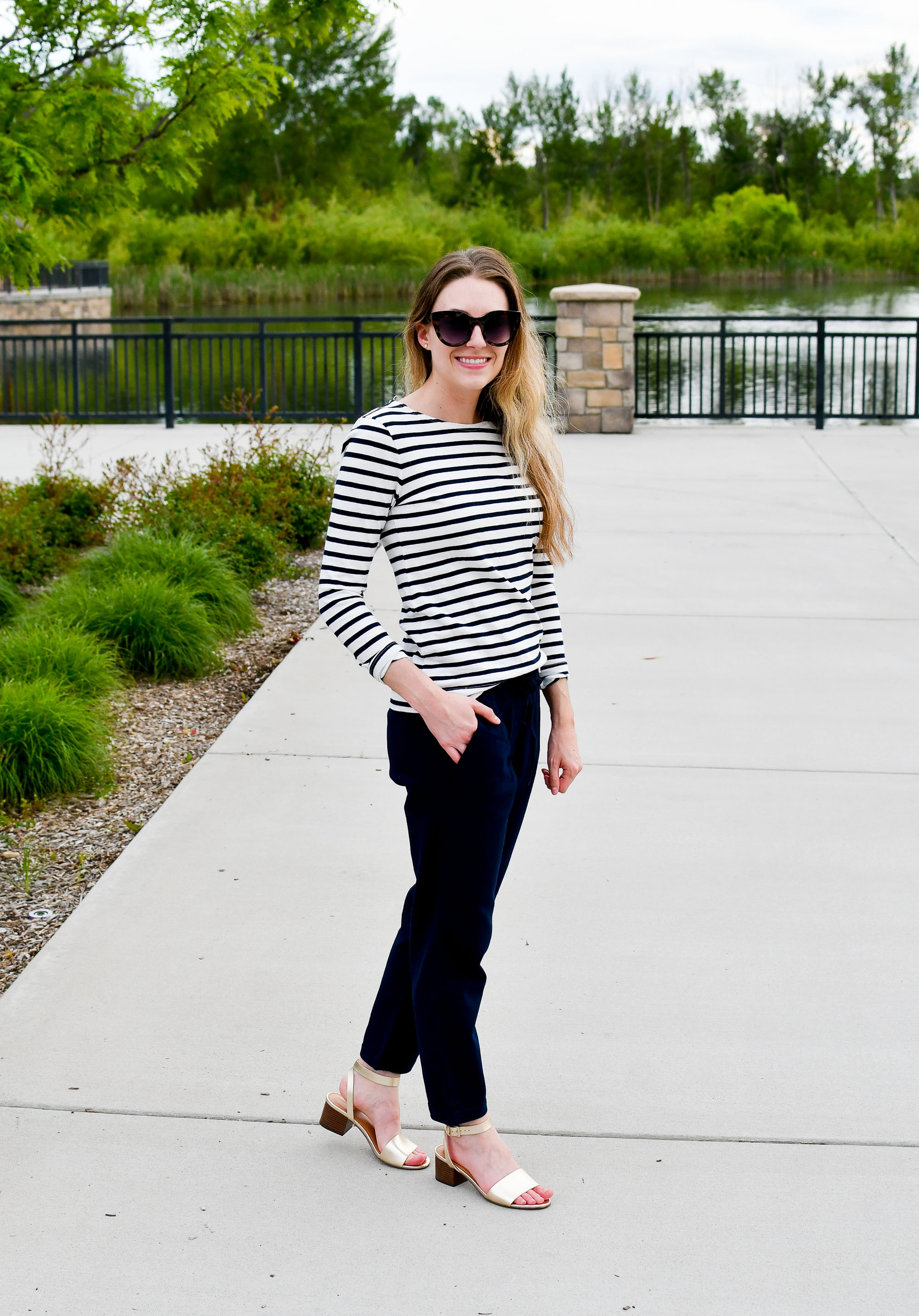 Spring work outfit with navy striped tee, cotton-linen pants, gold sandals — Cotton Cashmere Cat Hair