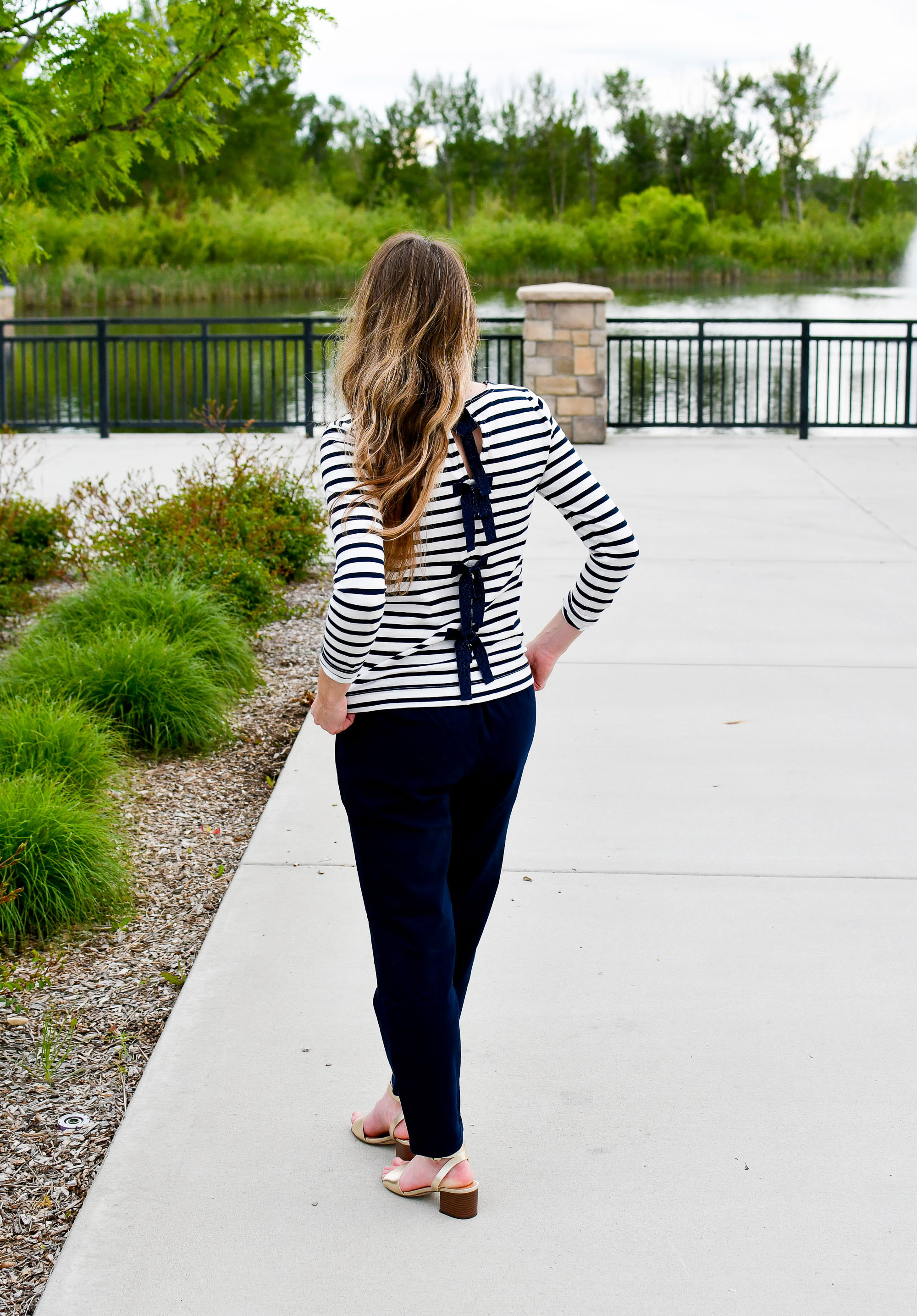 Navy bow back striped tee with navy cotton-linen pants and gold sandals — Cotton Cashmere Cat Hair