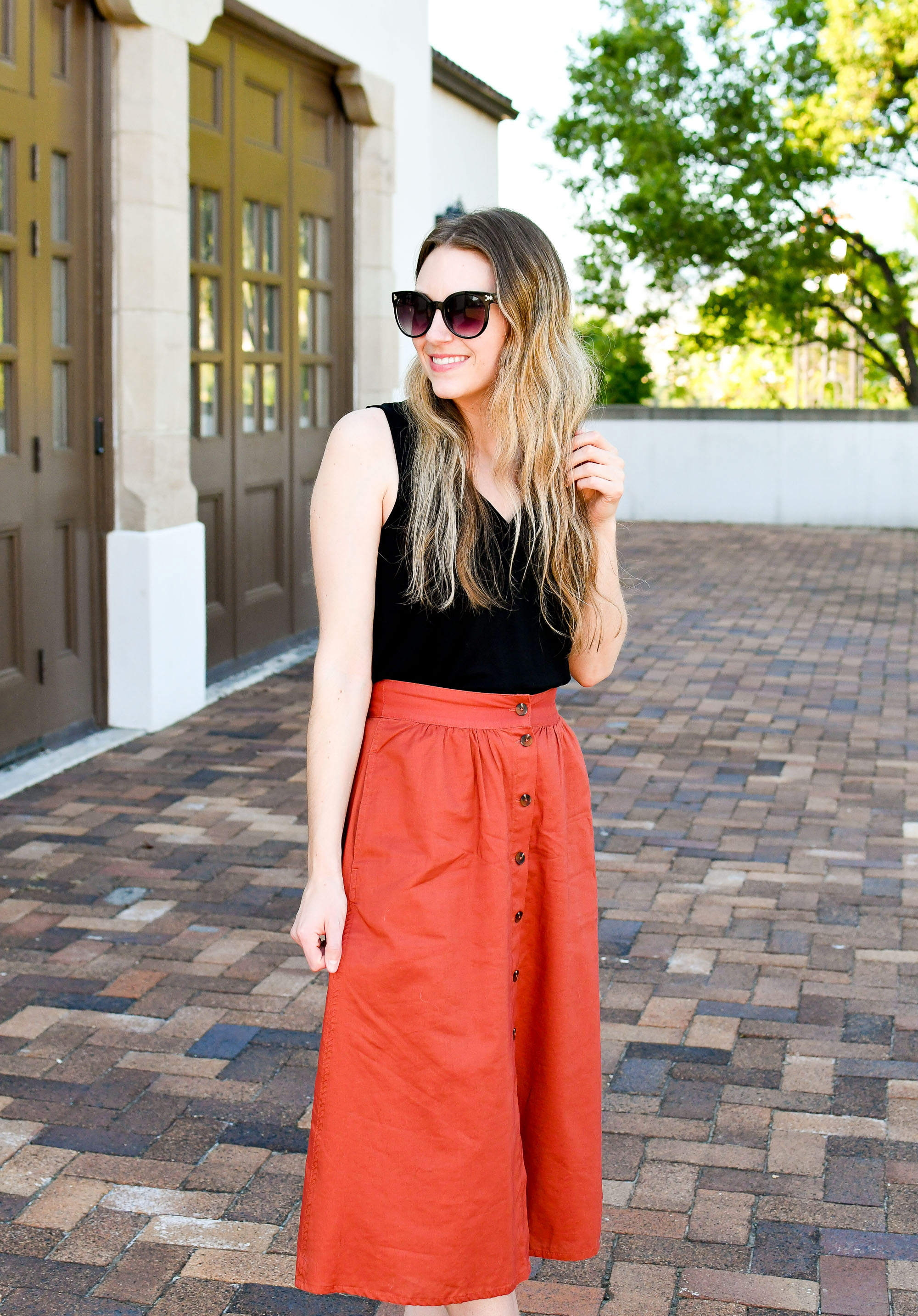 Red-orange midi skirt spring work outfit — Cotton Cashmere Cat Hair