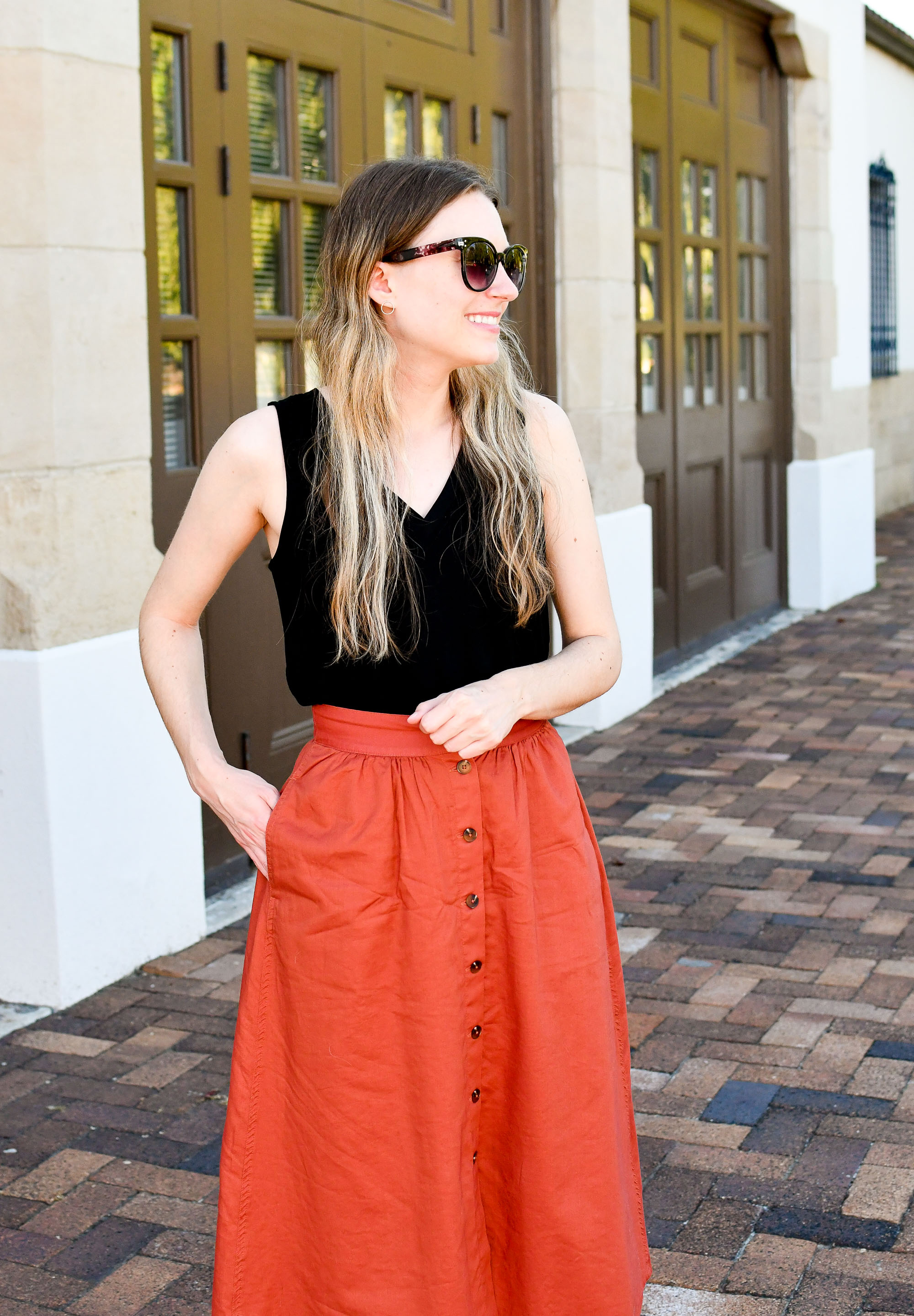 Rust midi skirt spring outfit with black tank top — Cotton Cashmere Cat Hair